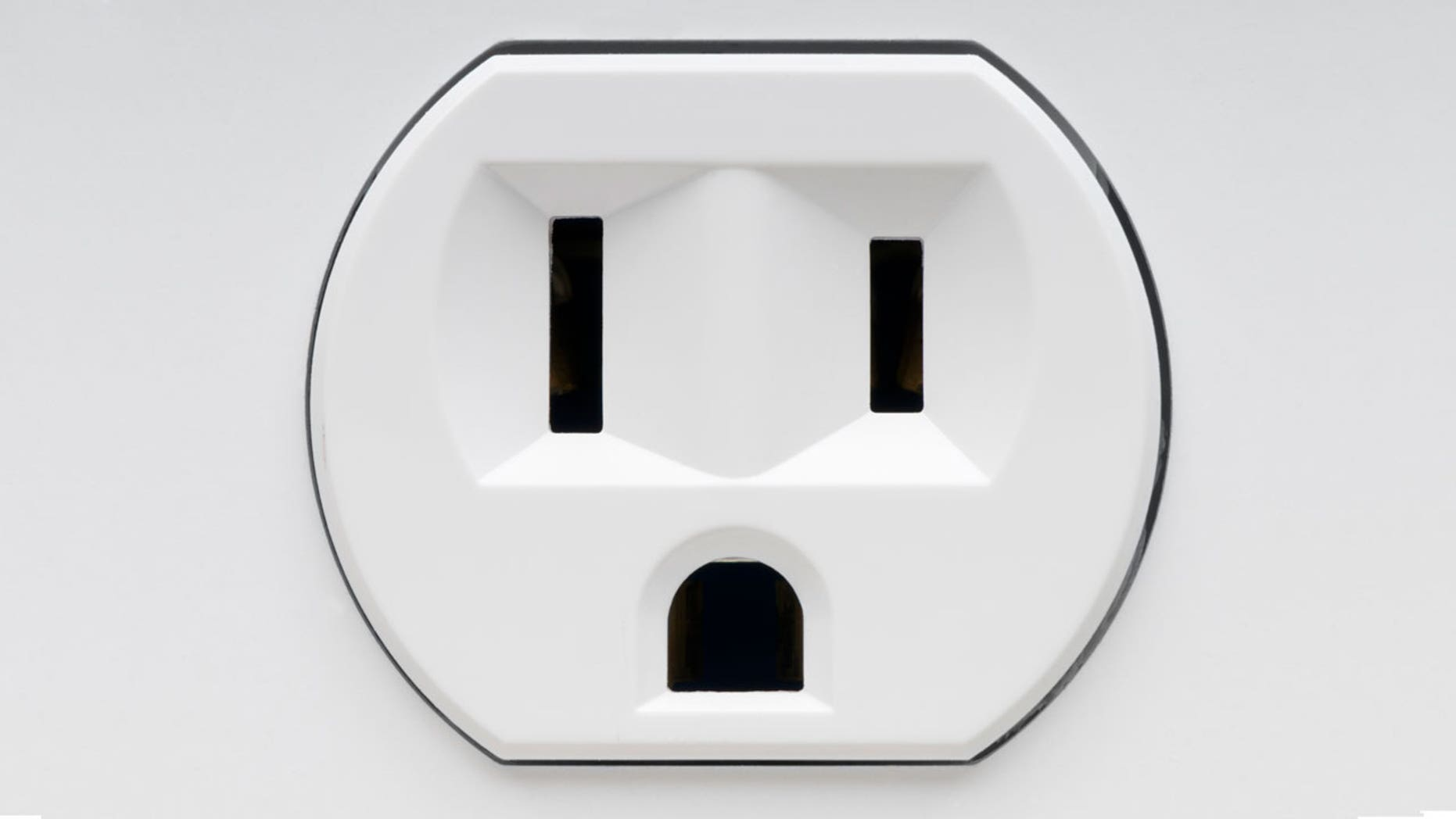 An prankster tricked passengers with a fake outlet sticker.