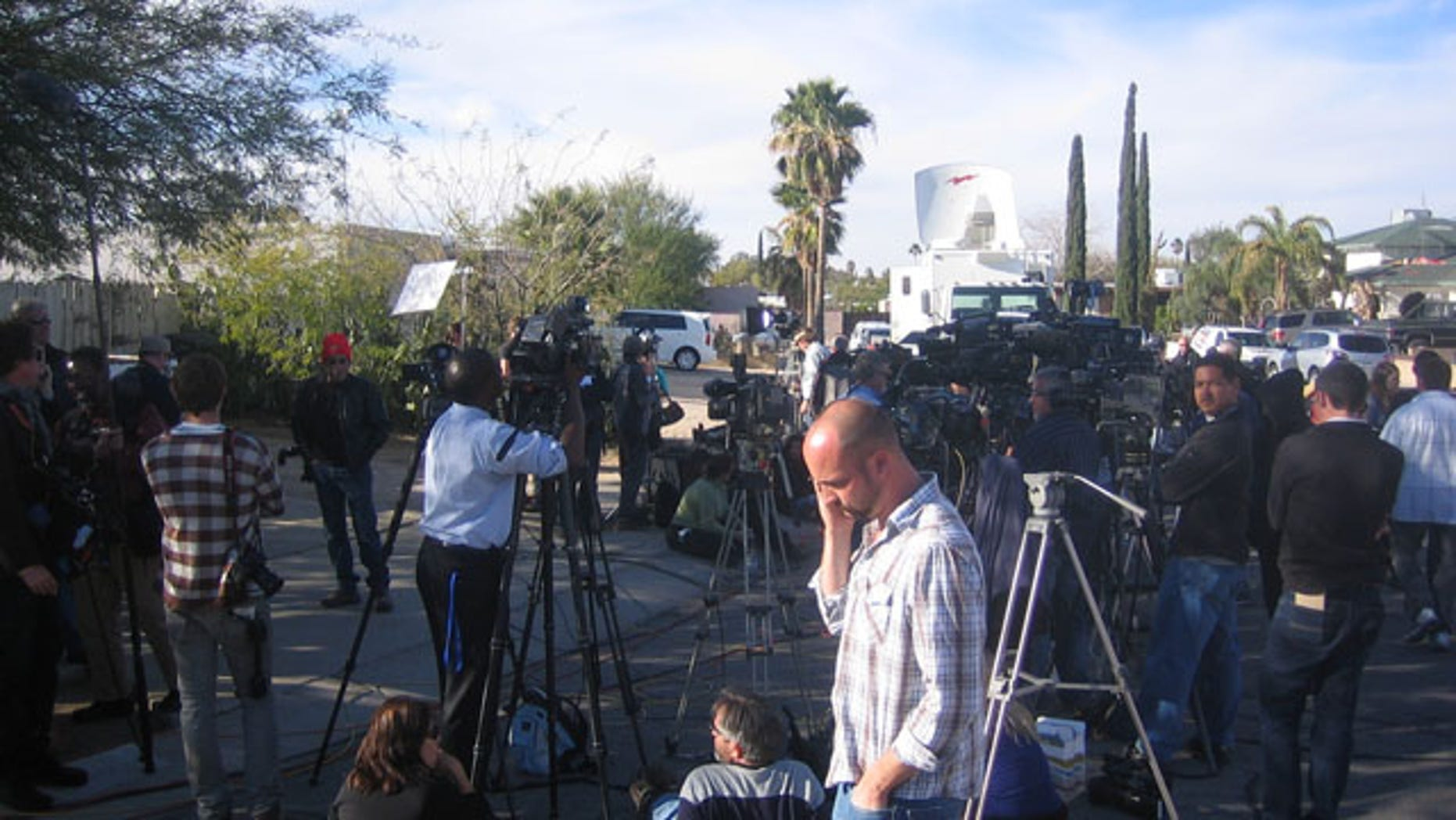 Jan. 11, 2011: Reporters wait for a press conference outside the home of the alleged shooter in a Tucson shopping center