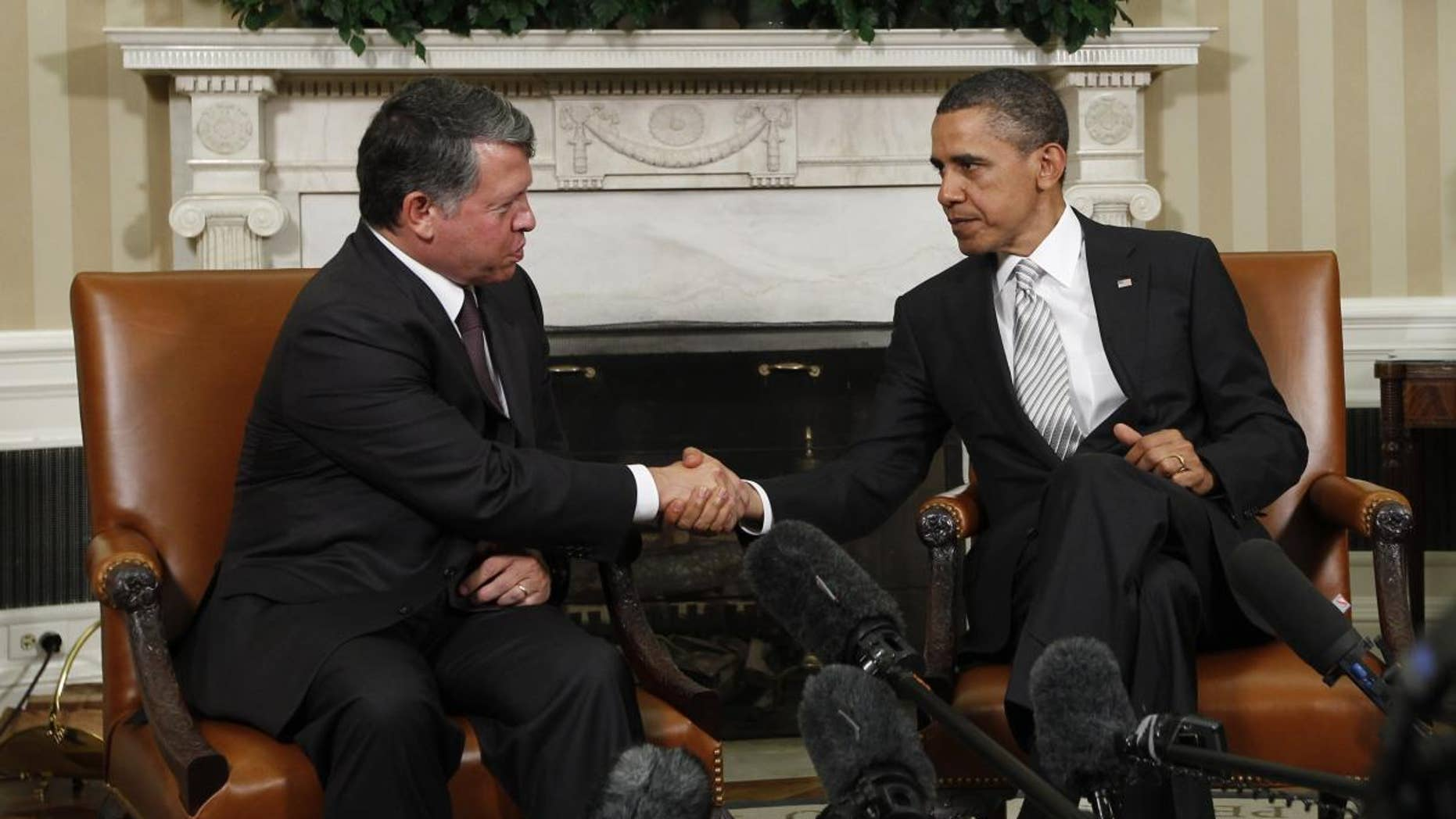 AP image of President Obama and King Abdullah making remarks to the press in the Oval Office.