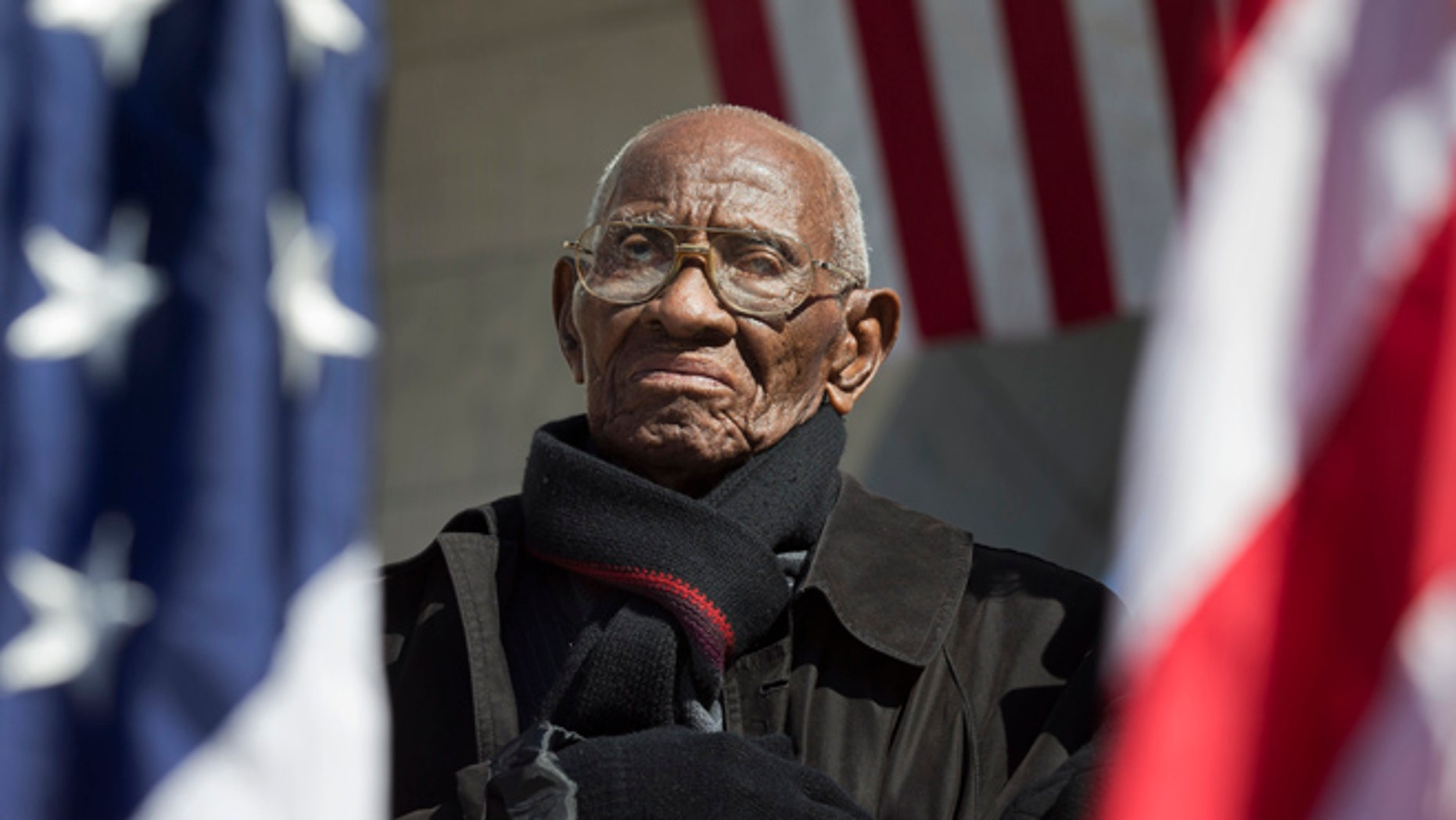 Richard Overton, the oldest living WWII veteran, listens during a Veterans Day ceremony at Arlington National Cemetery in Arlington, Va., in 2013.
