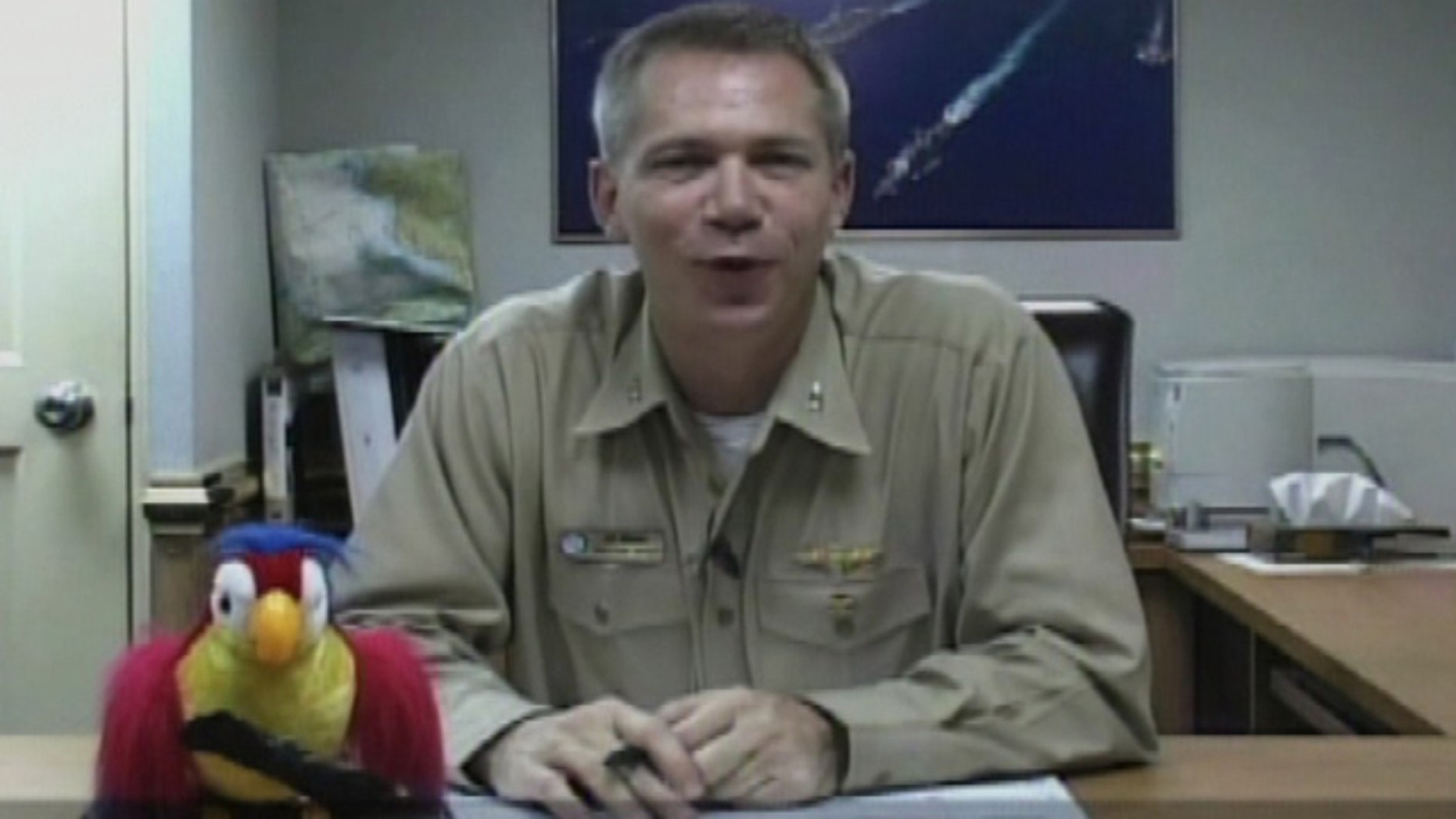 FILE: Capt. Owen Honors of the USS Enterprise aircraft carrier is pictured in an unidentified location in this still image taken from a video.