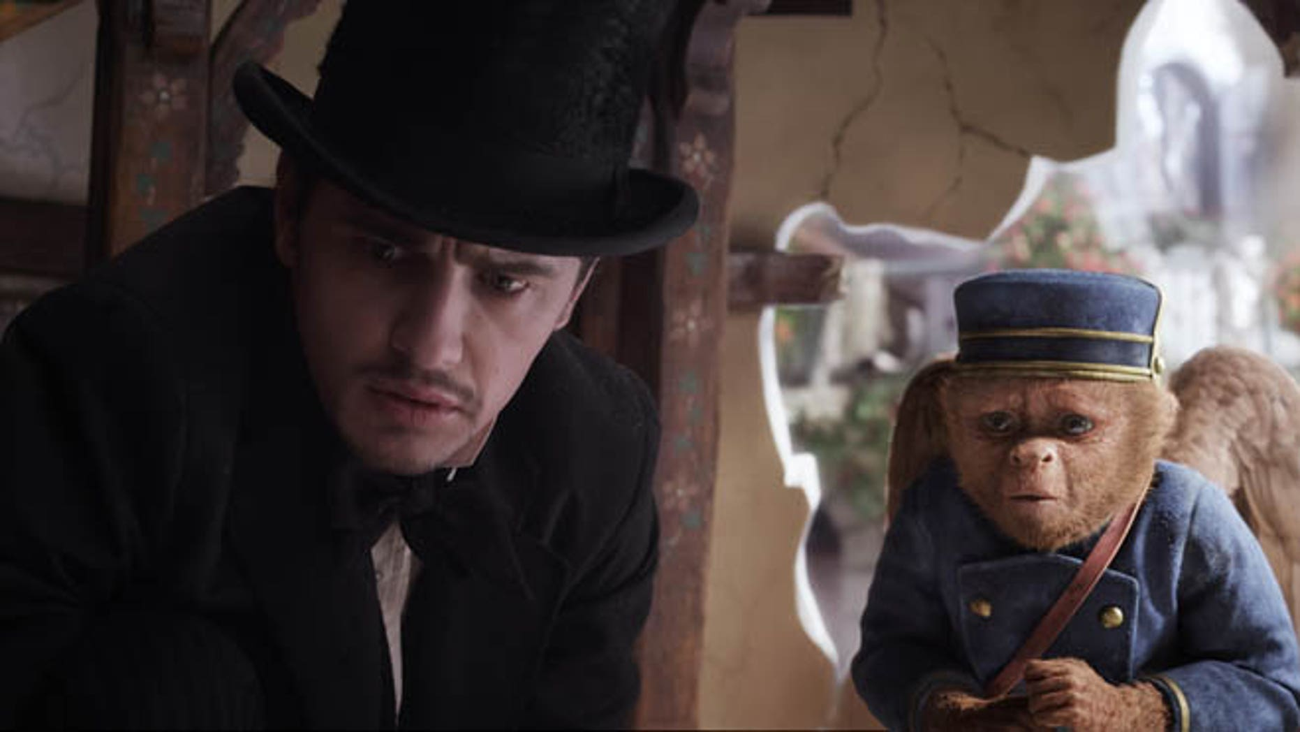 "This file film image provided by Disney Enterprises shows James Franco, as Oz, left, and the character Finley, voiced by Zach Braff, in a scene from ""Oz the Great and Powerful."" Oz the Great and Powerful is living up to its name at the box office. Walt Disney's 3-D blockbuster has led all films for the second week in a row, taking in $42.2 million according to studio estimates."