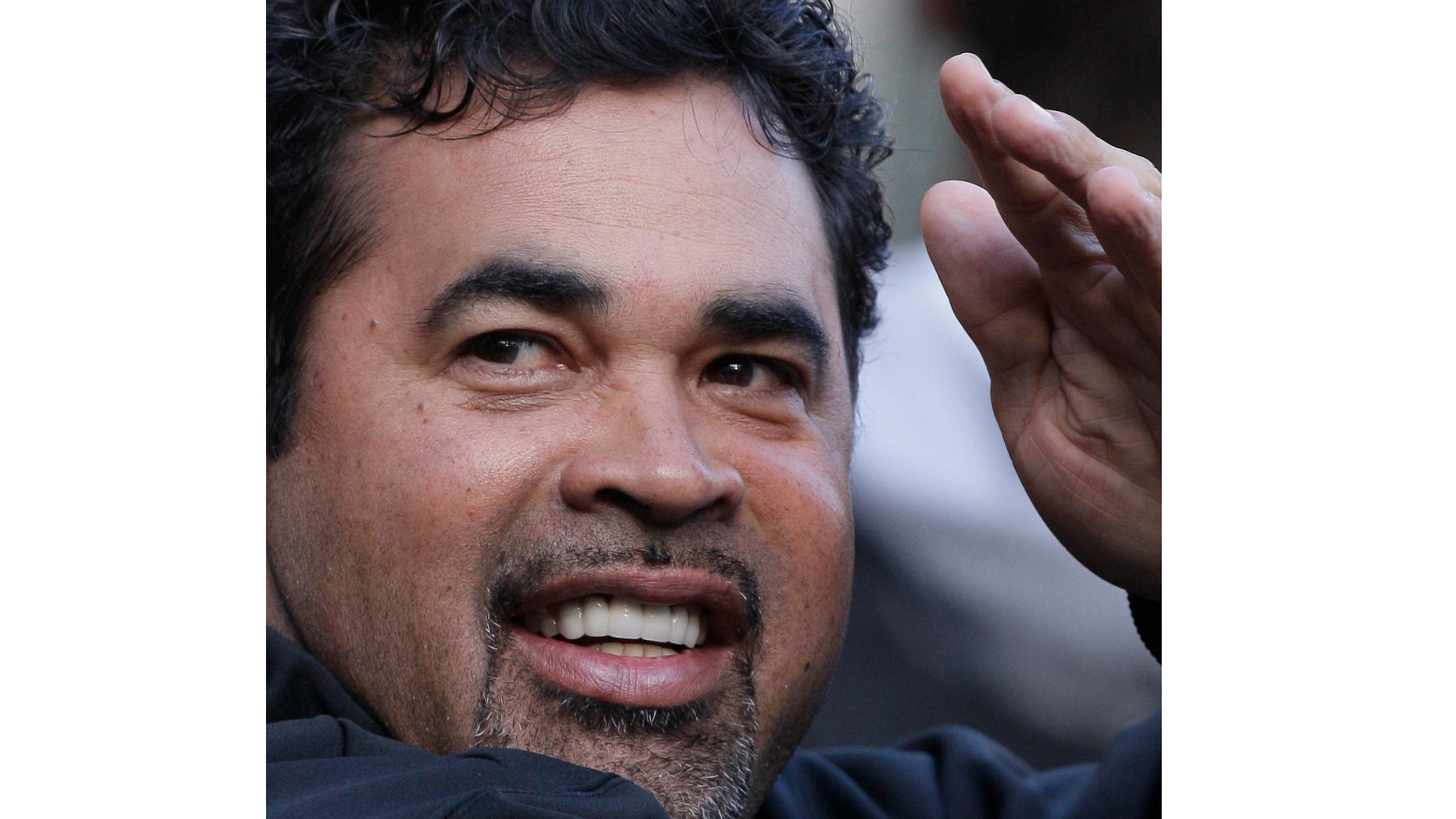 Sept 24: Ozzie Guillen smiles as he waves to fans.