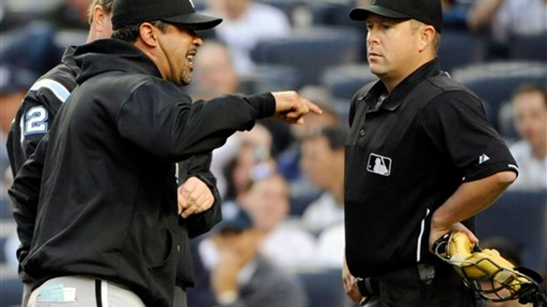 Chicago White Sox mamager Ozzie Guillen, left, argues with home plate umpire Todd Tichenor during the first inning of a baseball game against the New York Yankees, Wednesday, April 27, 2011, at Yankee Stadium in New York. (AP Photo/Bill Kostroun)