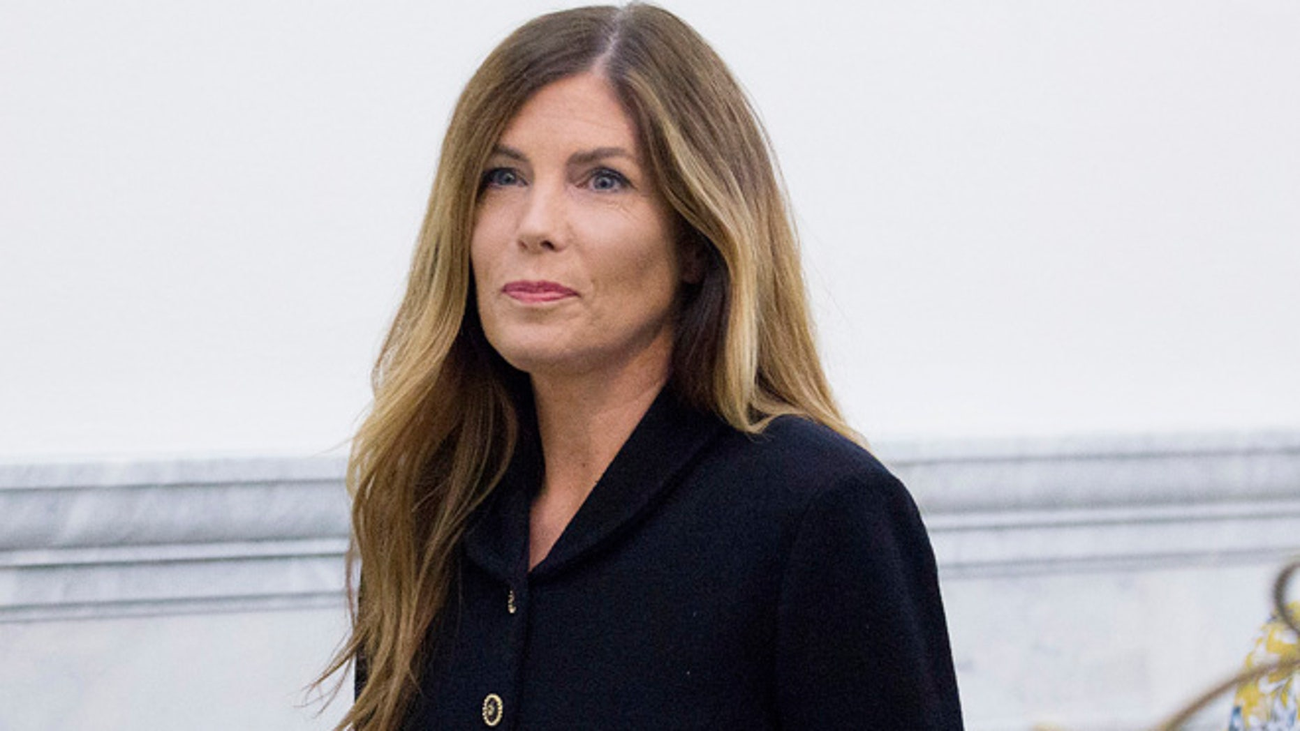 Pennsylvania Attorney General Kathleen Kane walks down a hall at the Montgomery County Courthouse, Monday, Aug. 15, 2016, in Norristown, Pa., where closing arguments are expected during her perjury and obstruction trial. (Jessica Griffin/The Philadelphia Inquirer via AP, Pool)