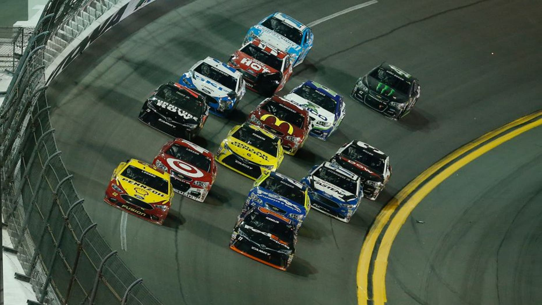 DAYTONA BEACH, FL - FEBRUARY 13: Denny Hamlin, driver of the #11 FedEx Express Toyota, and Joey Logano, driver of the #22 Shell Pennzoil Ford, lead a pack of cars during the NASCAR Sprint Cup Series Sprint Unlimited at Daytona International Speedway on February 13, 2016 in Daytona Beach, Florida. (Photo by Matt Sullivan/Getty Images)