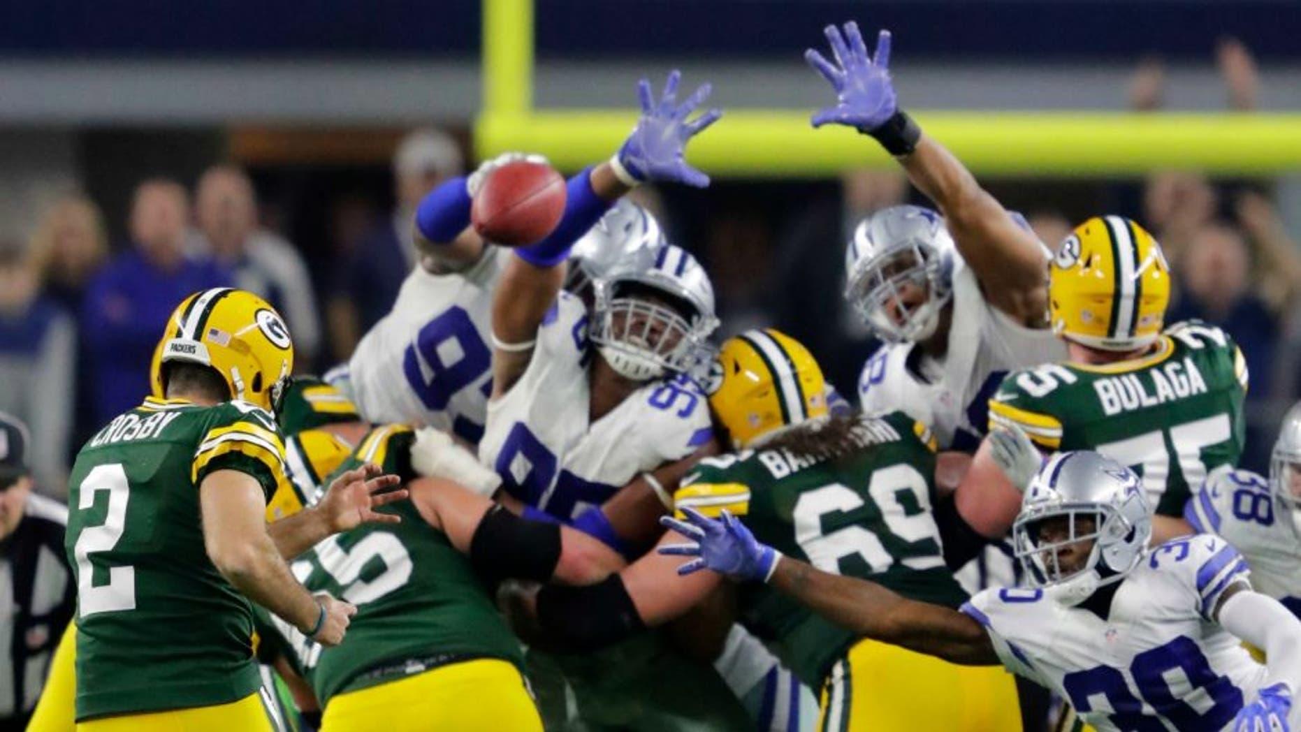 Jan 15, 2017; Arlington, TX, USA; Green Bay Packers kicker Mason Crosby (2) kicks the game winning field goal against the Dallas Cowboys in the NFC Divisional playoff game at AT&T Stadium. Mandatory Credit: Dan Powers/The Post-Crescant via USA TODAY NETWORK