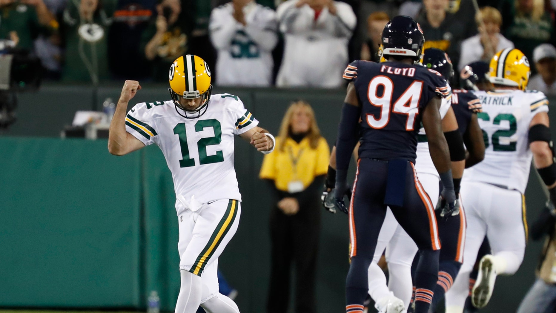 Green Bay Packers' Aaron Rodgers celebrates a touchdown pass during the first half of an NFL football game against the Chicago Bears Thursday, Sept. 28, 2017, in Green Bay, Wis. (AP Photo/Matt Ludtke)