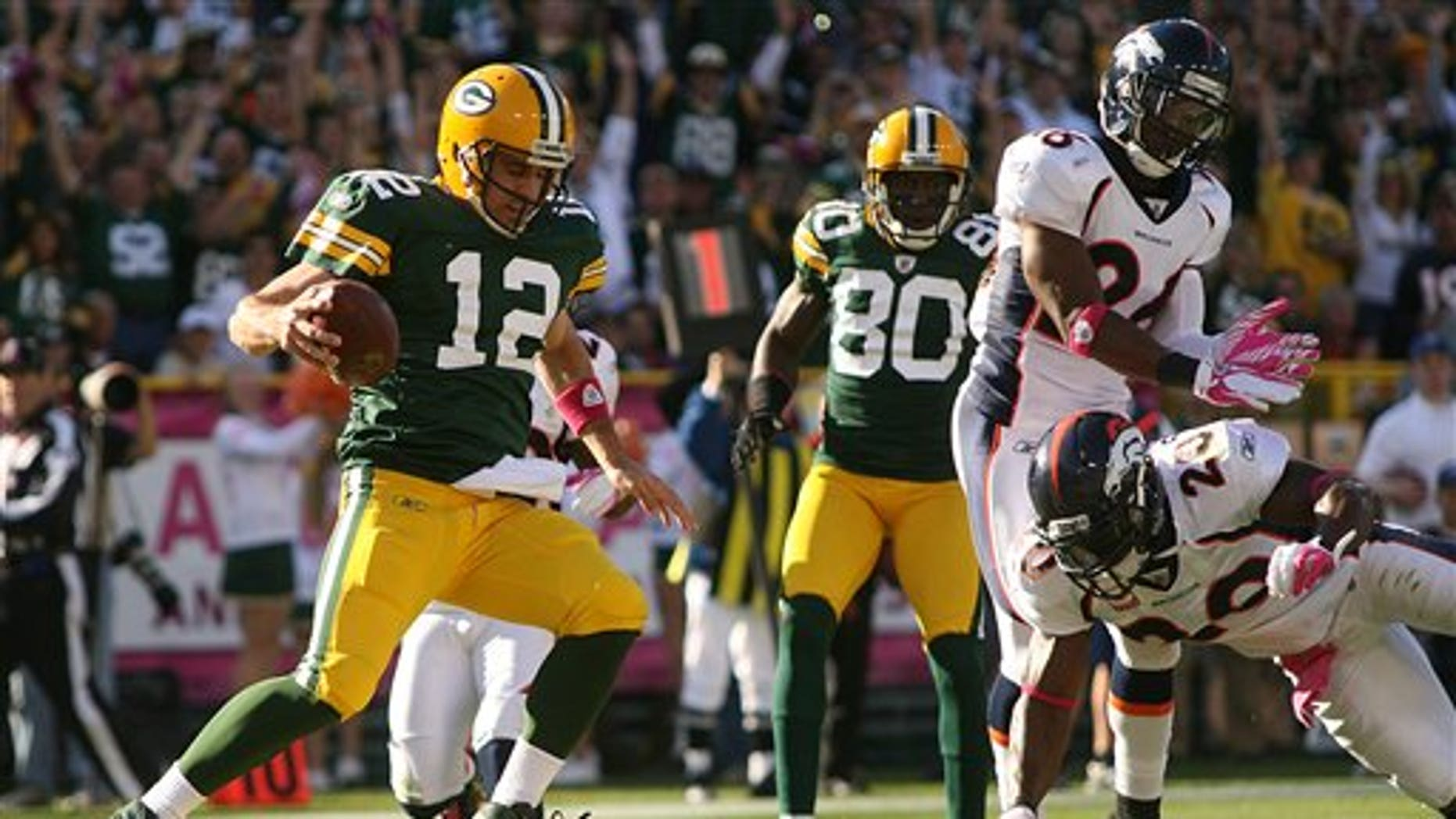 Oct. 2: Green Bay Packers quarterback Aaron Rodgers (12) runs in for a touchdowns in the second quarter of an NFL football game against the Denver Broncos at Lambeau Field in Green Bay, Wis.