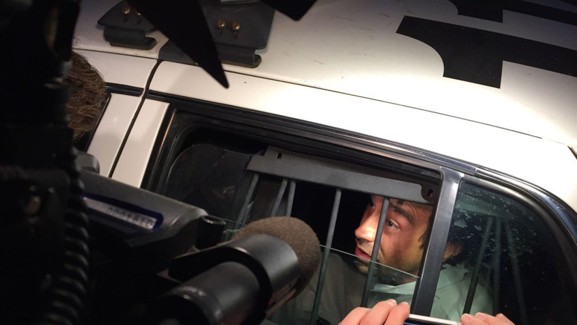 Suspect Anthony Padgett arriving at a jail for booking.