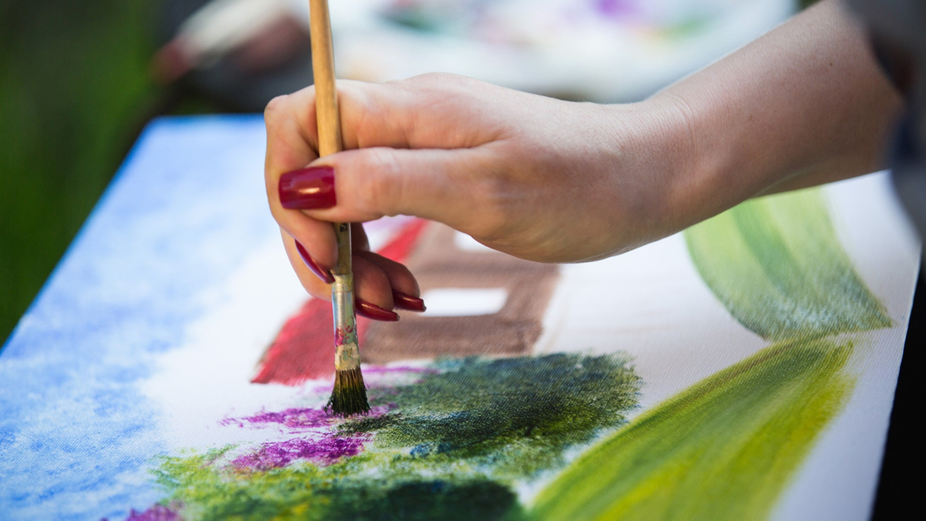painter paints a painting