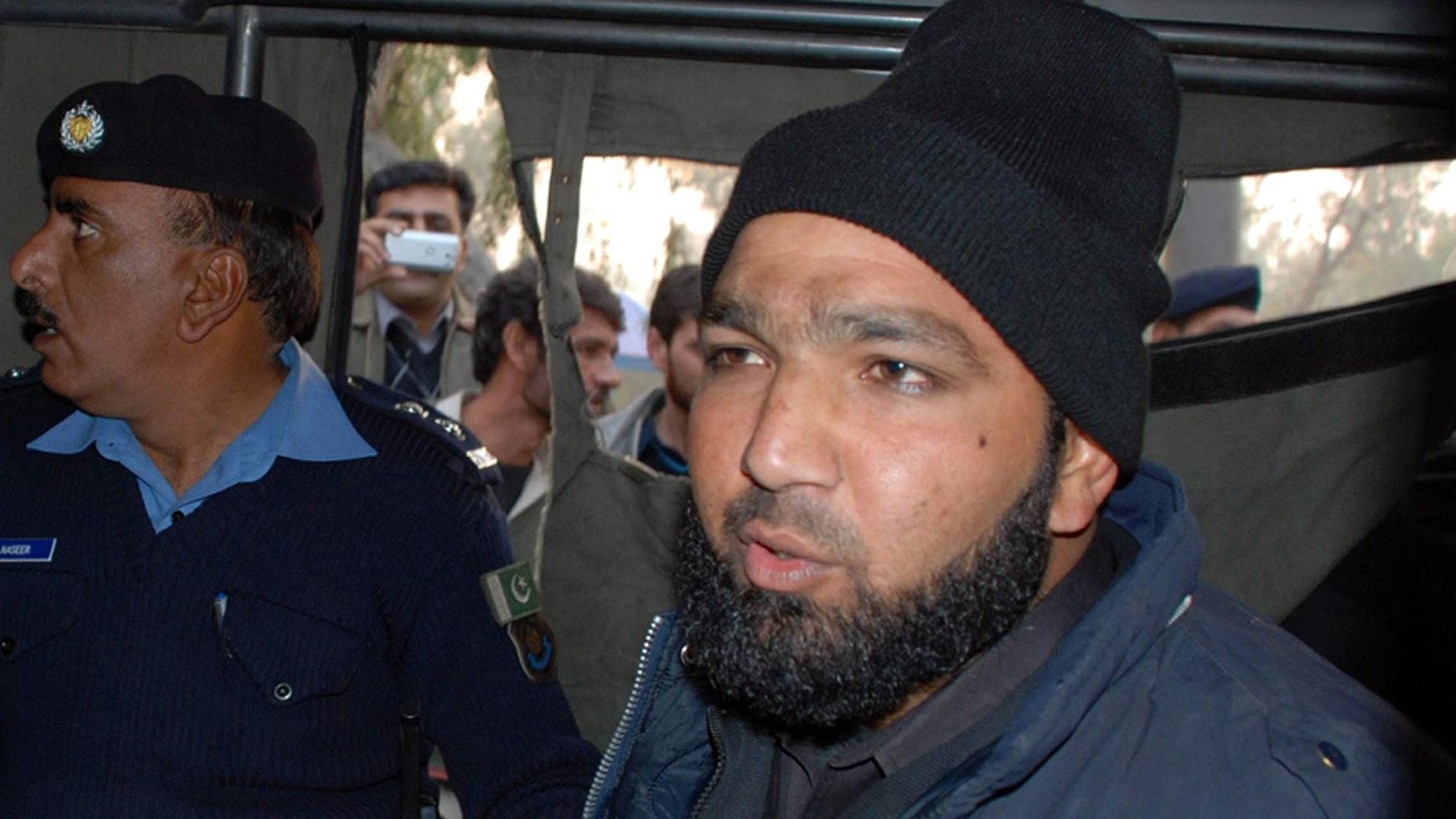 Jan. 4, 2011: Commando of Pakistan's Elite force Mumtaz Qadri, right, who killed Punjab's Gov. Salman Taseer, sits in police custody in Islamabad, Pakistan.