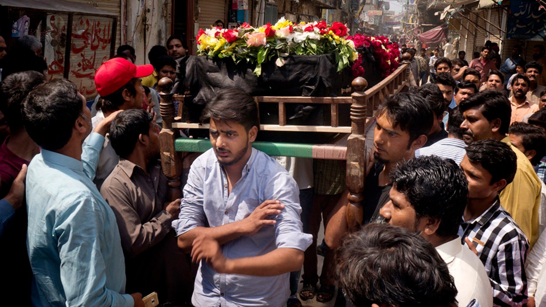 March 28, 2016: People prepare to bury the body of a Christian man killed in a bomb attack in Lahore, Pakistan.
