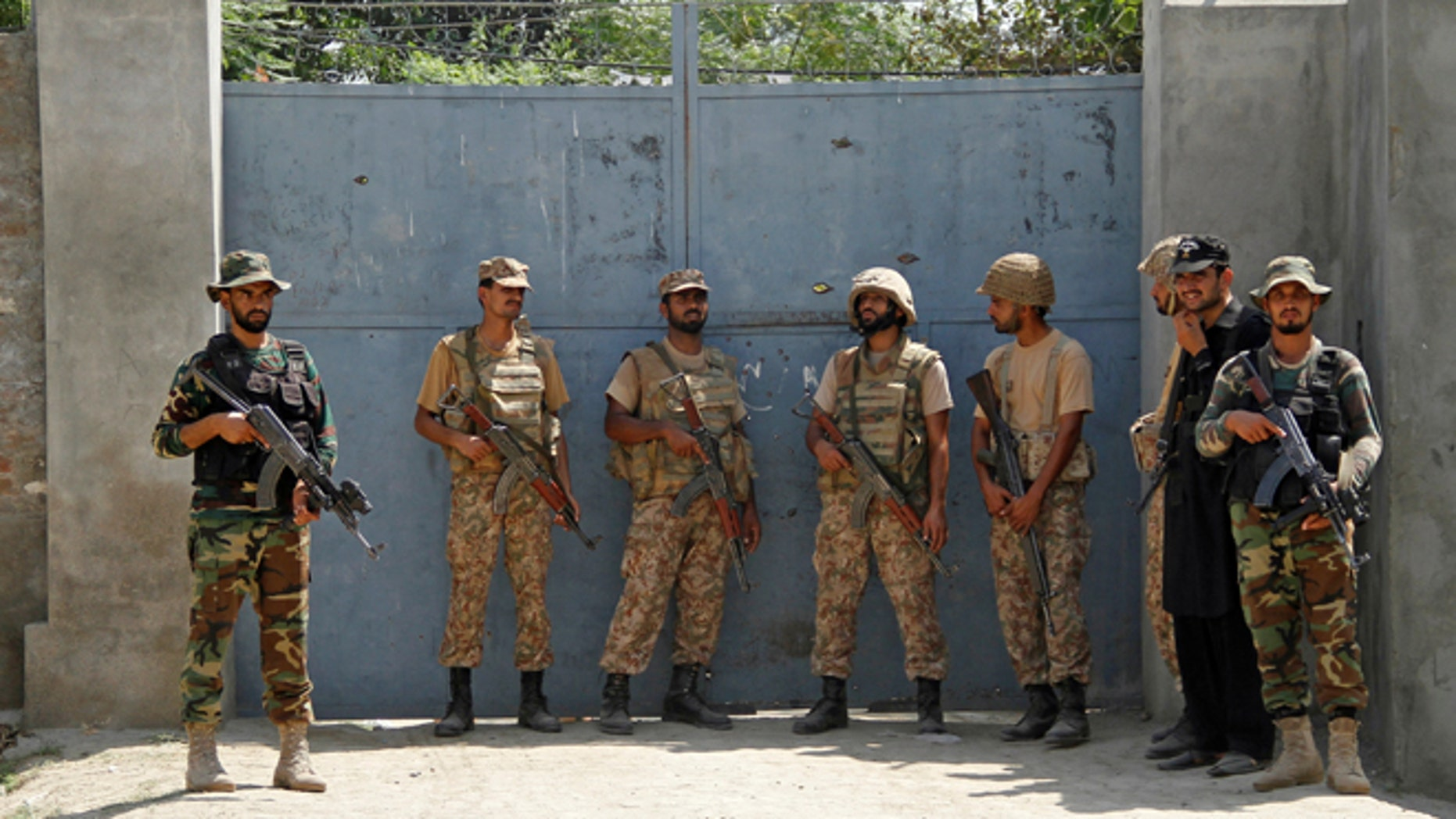 Pakistan Army soldiers stand guard at an entrance gate, after suicide bombers attacked a Christian neighborhood in Khyber Agency near Peshawar, Pakistan, September 2, 2016.