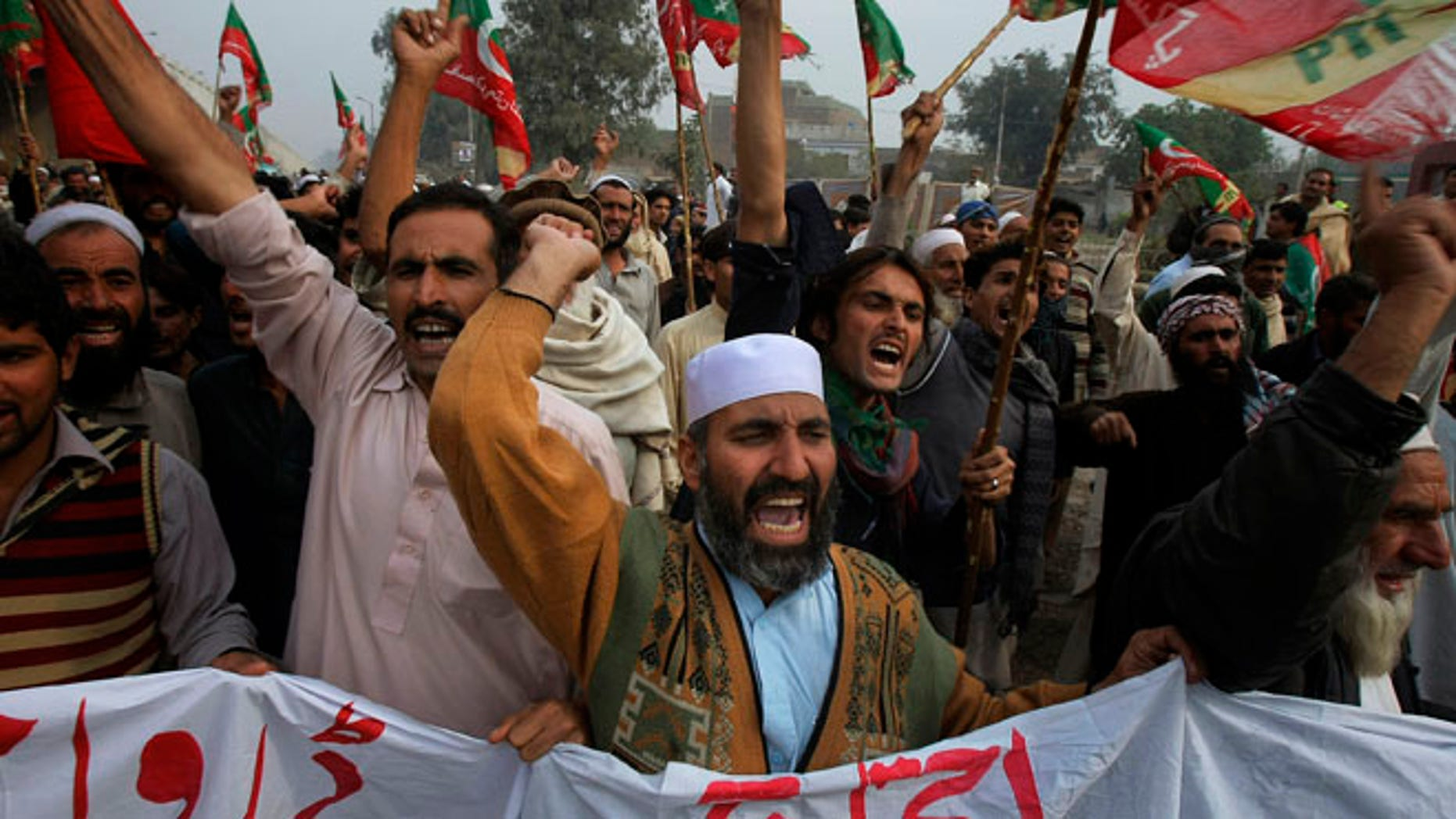 Nov. 23, 2013: Supporters of Tehreek-e-Insaf or Movement for Justice party chant anti-U.S. slogans during a rally in Peshawar, Pakistan. Thousands of people protesting U.S. drone strikes blocked a road in northwest Pakistan used to truck NATO troop supplies and equipment in and out of Afghanistan, the latest sign of rising tension caused by the attacks.