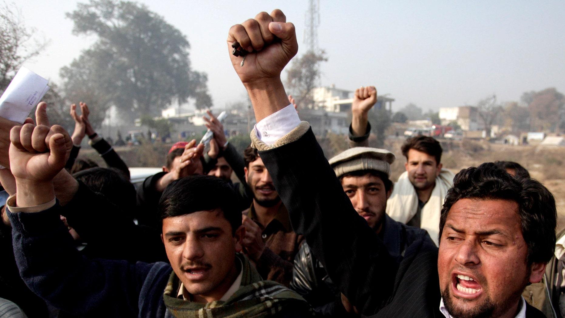 Pakistani students chant slogans to condemn the killing of Punjab's governor Salman Taseer in Peshawar, Pakistan Saturday, Jan. 8, 2011. (AP)