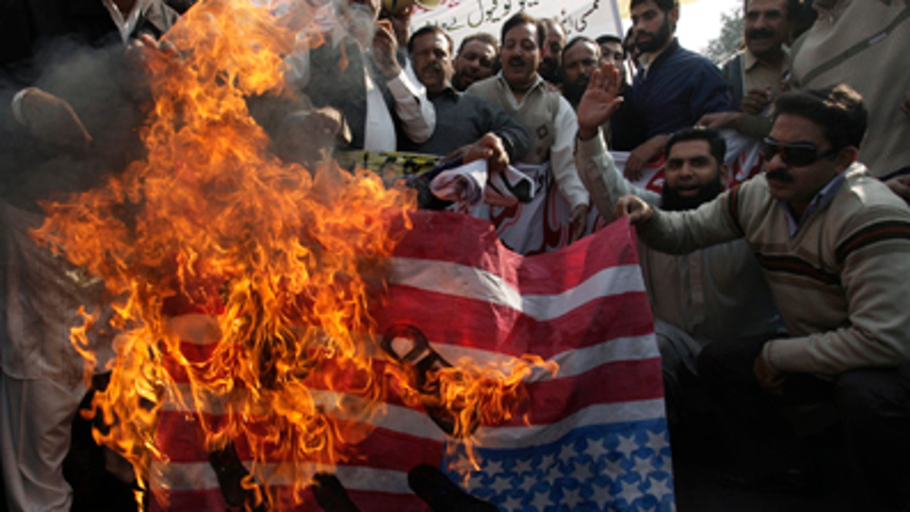Dec. 3, 2011: Pakistani workers burn a replica U.S. flag during a rally to condemn alleged NATO airstrikes on Pakistani troops. U.S. officials gave Pakistan soldiers the wrong location when asking for clearance to attack militants along the border last weekend, Pakistani military officials said Friday. The strike resulted in the deaths of 24 soldiers and a major crisis in relations between Washington and Islamabad.