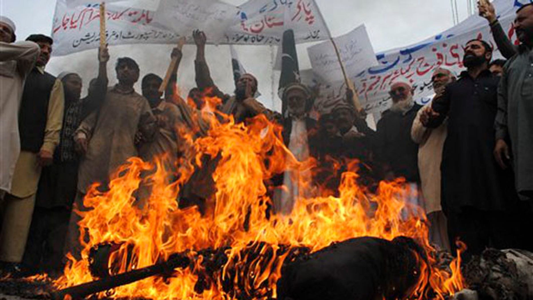 Dec. 1, 2011: Pakistani protesters burn an effigy of President Obama during a protest to condemn killings of Pakistani troops in NATO airstrikes, in Peshawar, Pakistan.