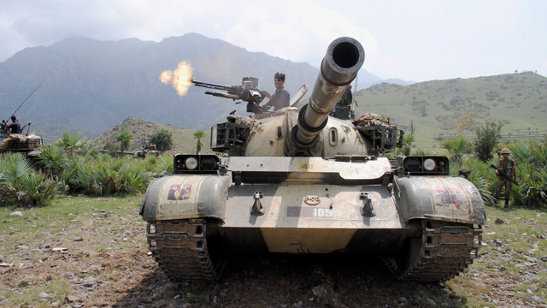 July 10: A Pakistani army soldier fires toward a target at a forward base during a military operation against militants in Pakistan's Khurram tribal region. A military operation in Kurram tribal region has been launched to clear the area of terrorists involved in various terrorist activities, including kidnapping and killing of locals, suicide attacks and blocking the road connecting lower with upper Kurram, Pakistani army spokesman Maj. Gen. Athar Abbas said.