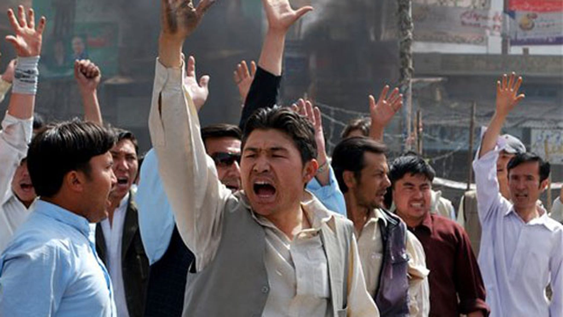 March 29, 2012: Pakistani protesters shout slogans against government to condemn killings in Quetta, Pakistan after an attack by a gunman who appeared to target local employees of the United Nations Food and Agriculture Organization, officials said.