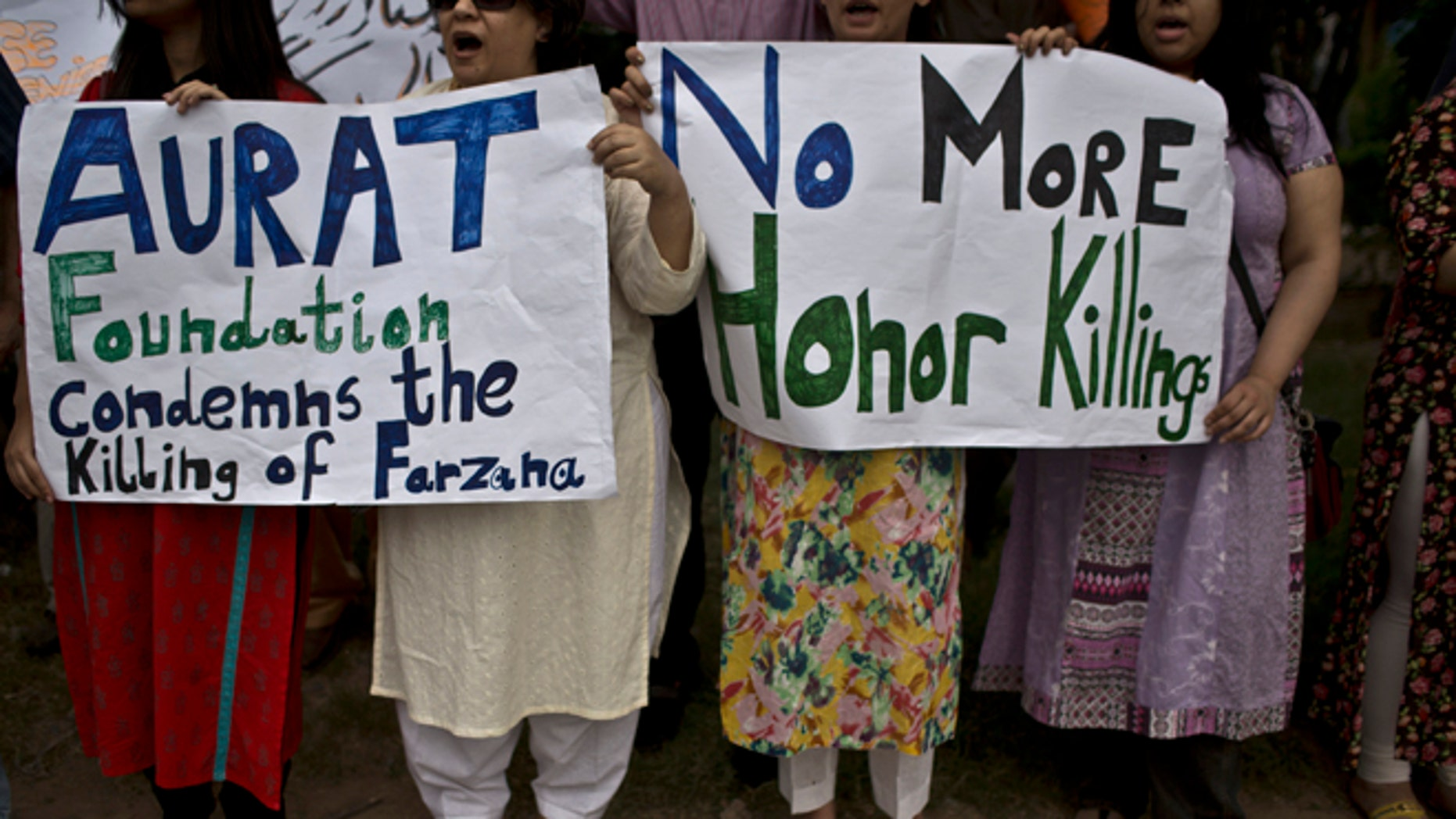 May 29, 2014: Members of Pakistan's civil society, hold banners and chant slogans, during a protest to condemn the killing of pregnant woman Farzana Parveen, who was stoned to death, in Islamabad, Pakistan. (AP)
