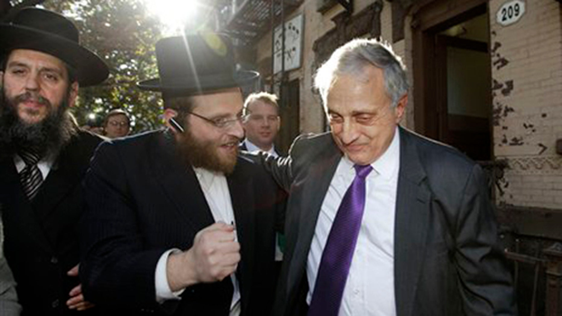 Rabbi Yechezkel Roth, left, and another Orthodox Jewish supporter, center, accompany New York Republican gubernatorial candidate Carl Paladino in the Williamsburg neighborhood of Brooklyn Oct. 10. (AP Photo)