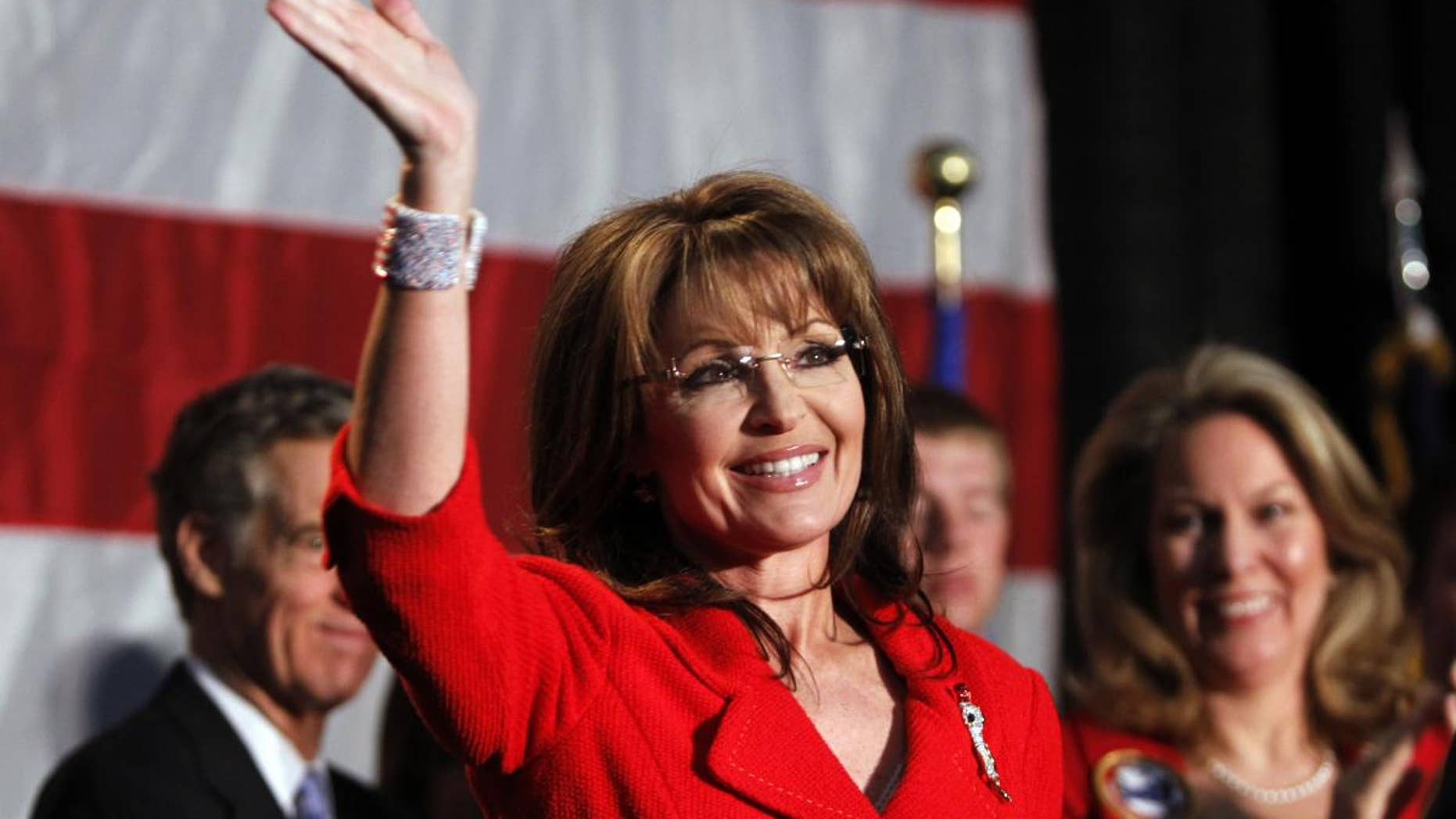 In this May 2, 2011, file photo, former Alaska Governor Sarah Palin waves during a fundraiser at Colorado Christian University in Lakewood, Colo. (AP Photo/Ed Andrieski)