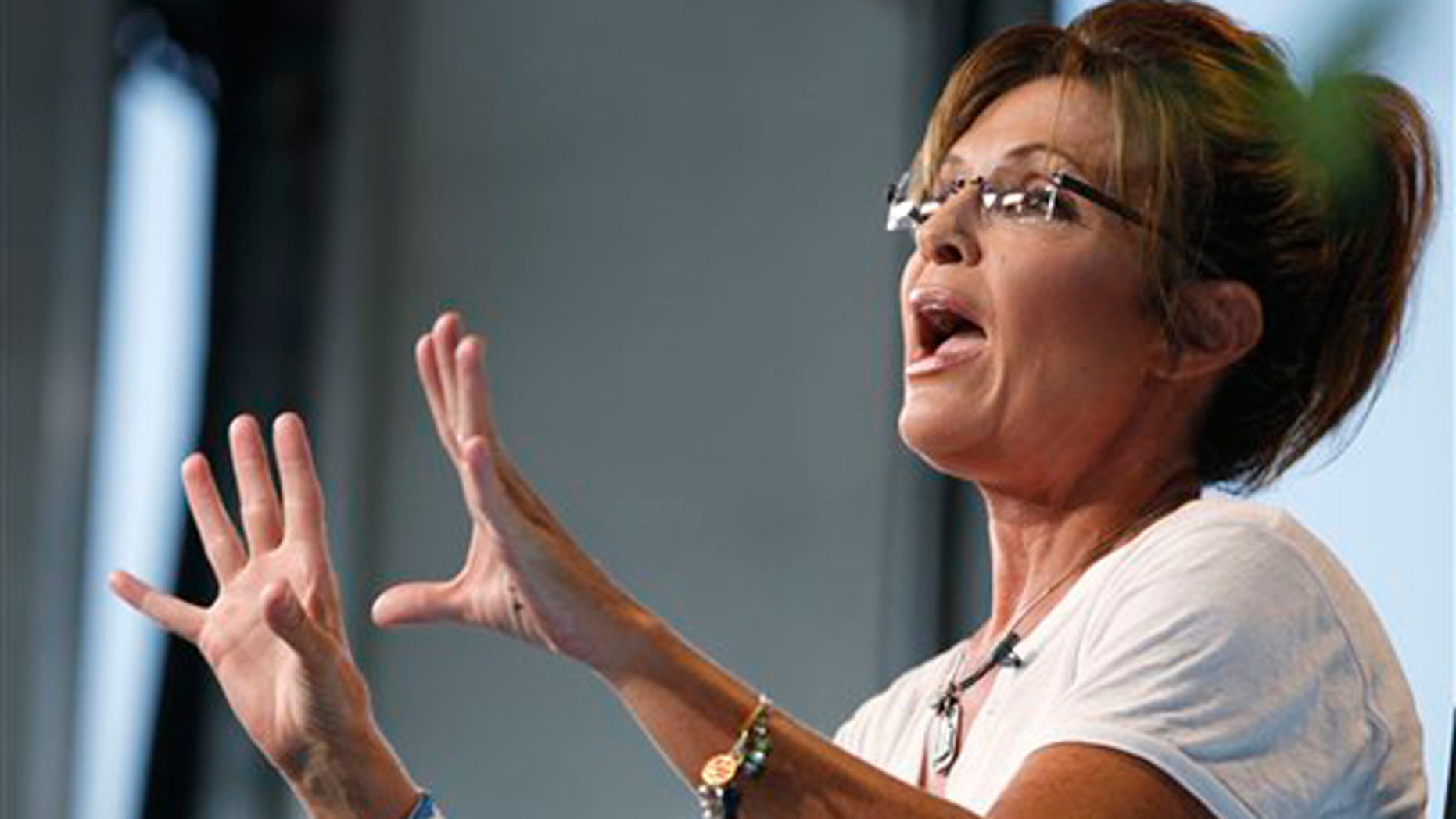 Former Alaska Gov. Sarah Palin speaks as she is interviewed by Fox News at the Iowa State Fair in Des Moines, Iowa, Aug. 12.
