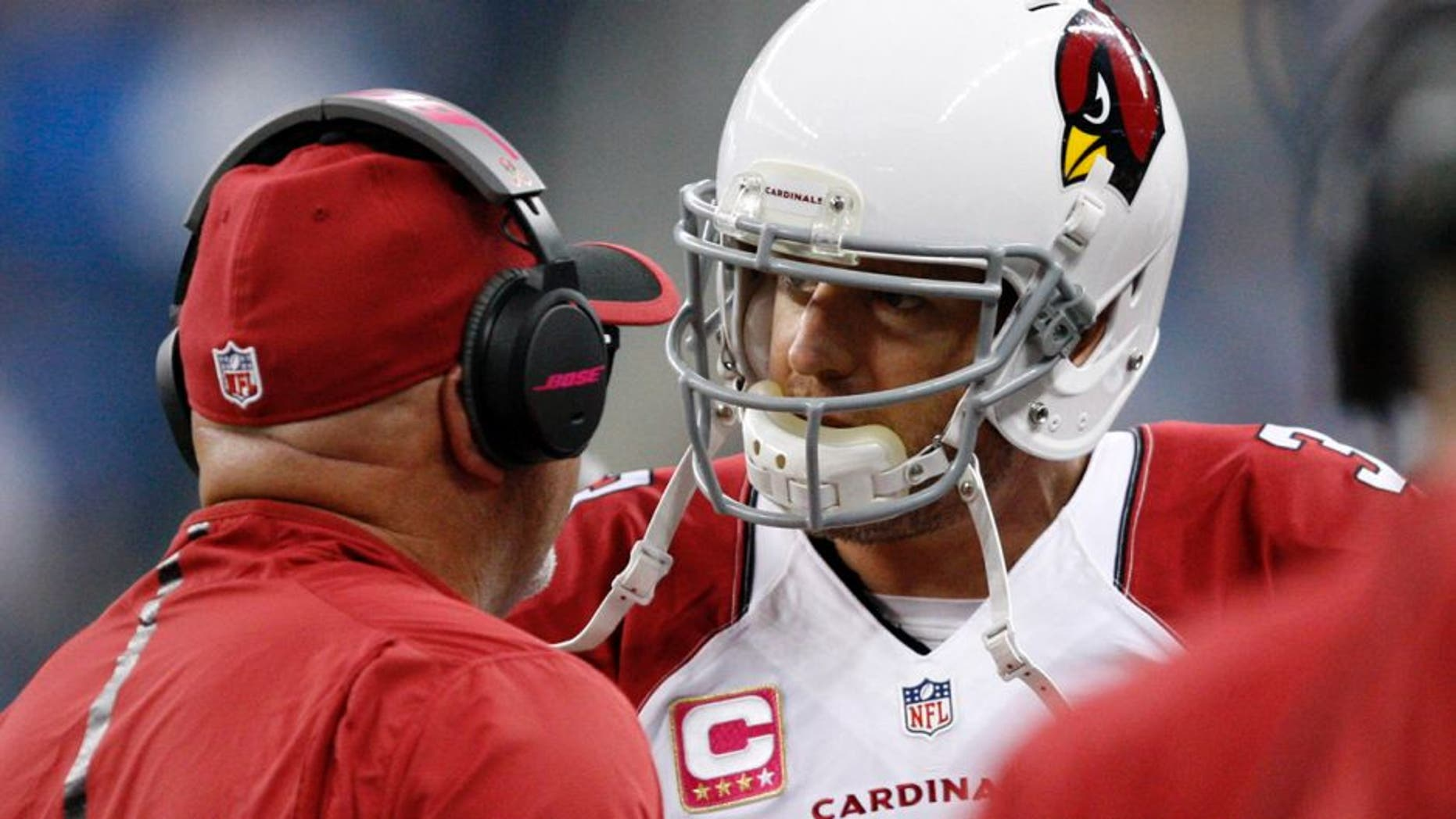 Oct 11, 2015; Detroit, MI, USA; Arizona Cardinals quarterback Carson Palmer (3) talks to head coach Bruce Arians right before the first quarter against the Detroit Lions at Ford Field. Mandatory Credit: Raj Mehta-USA TODAY Sports