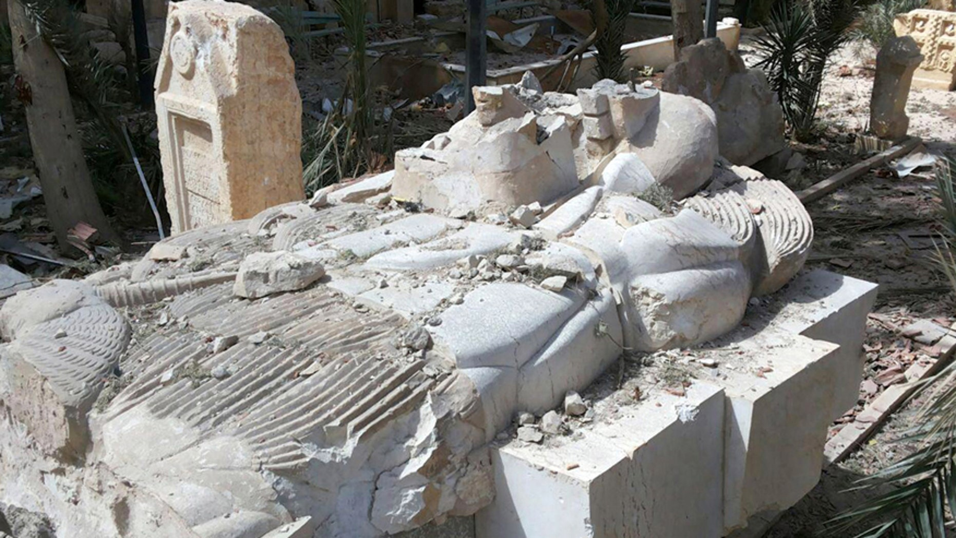 March 27, 2016: A destroyed statue outside the damaged Palmyra Museum, in Palmyra city, central Syria.