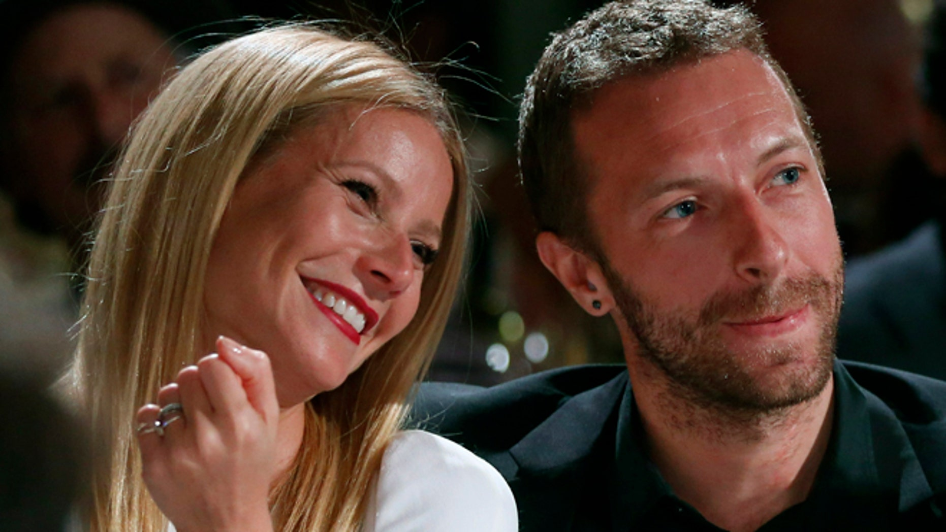 Jan. 11, 2014: Actress Gwyneth Paltrow, left, and her husband, singer Chris Martin at the 3rd Annual Sean Penn & Friends Help Haiti Home Gala in Beverly Hills, Calif.
