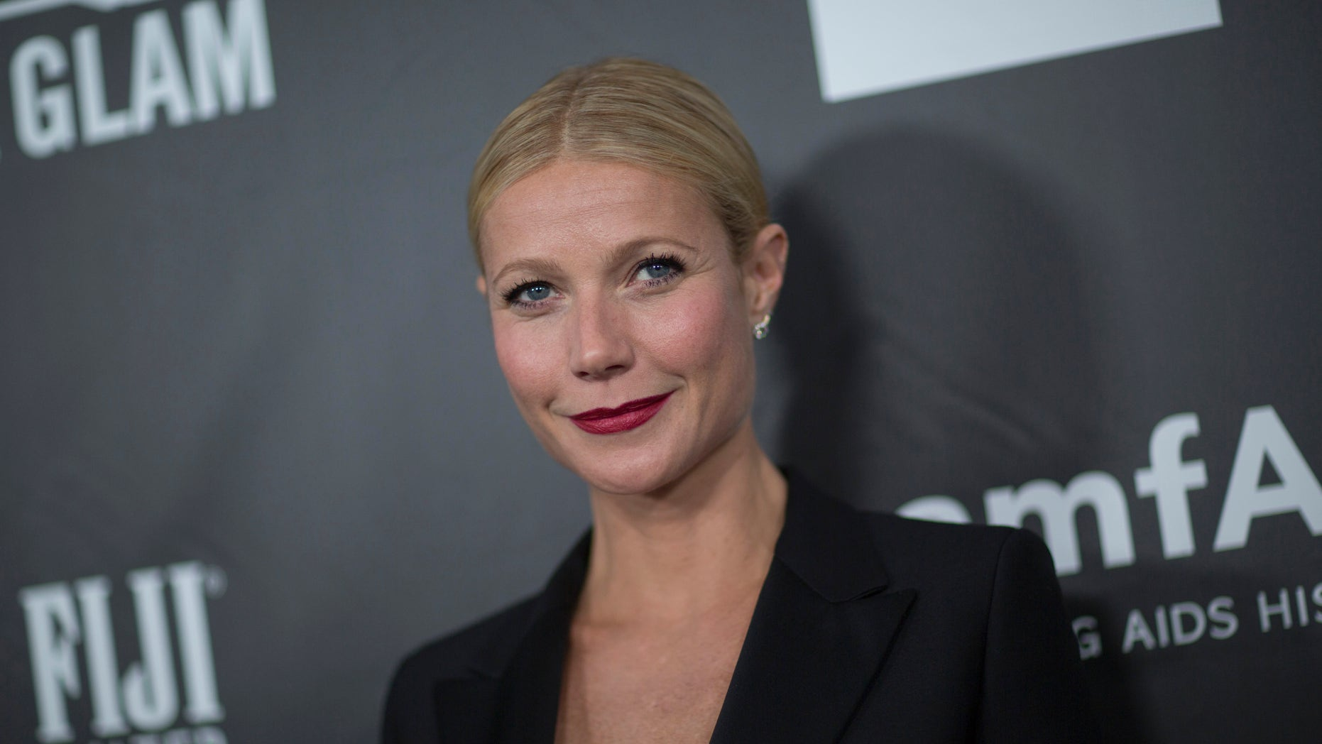 October 29, 2014. Gwyneth Paltrow poses at the amfAR's fifth annual Inspiration Gala in Los Angeles, California.