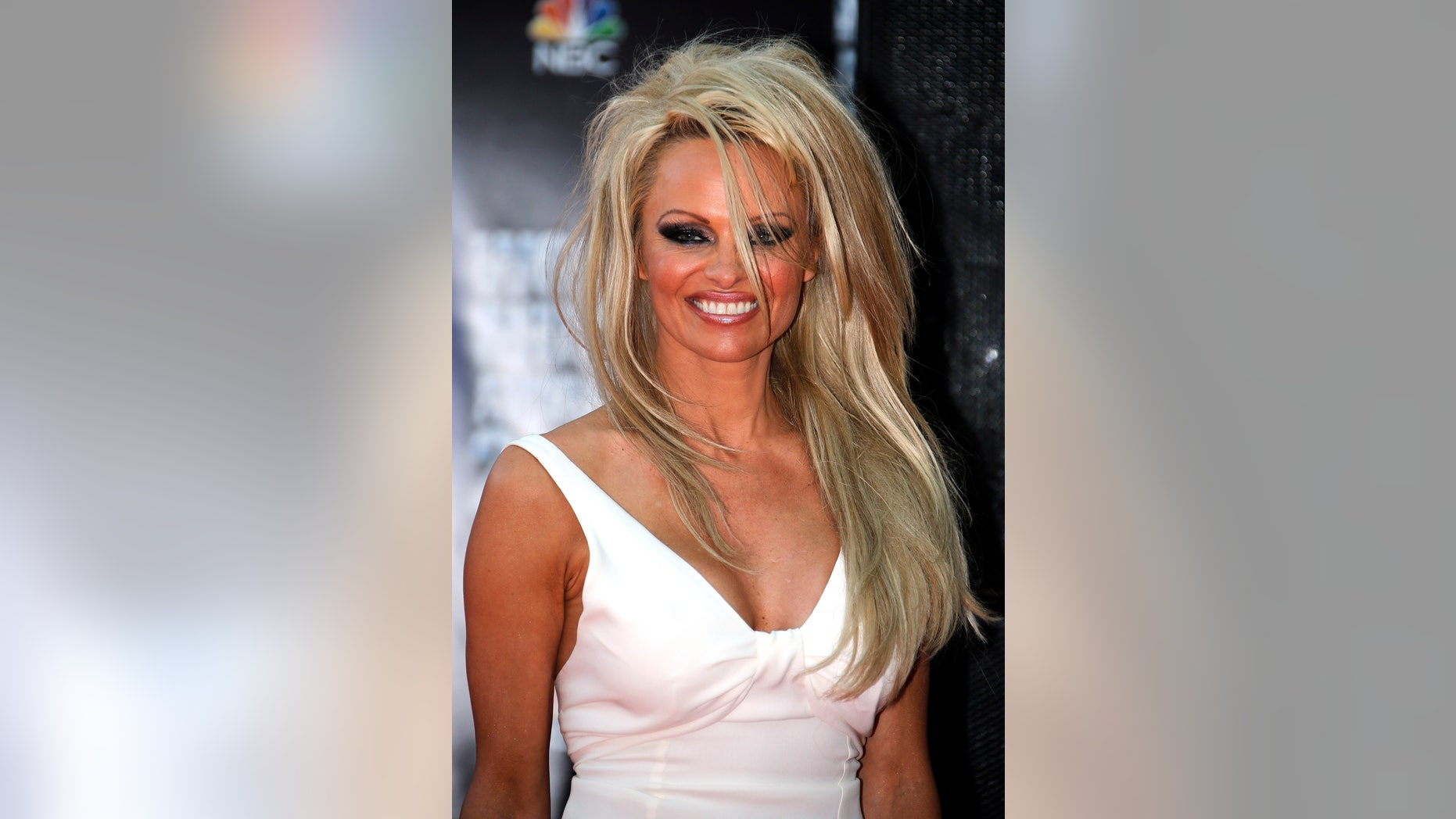 May 27, 2014. Pamela Anderson arrives to attend the World Music Awards in Monte Carlo.