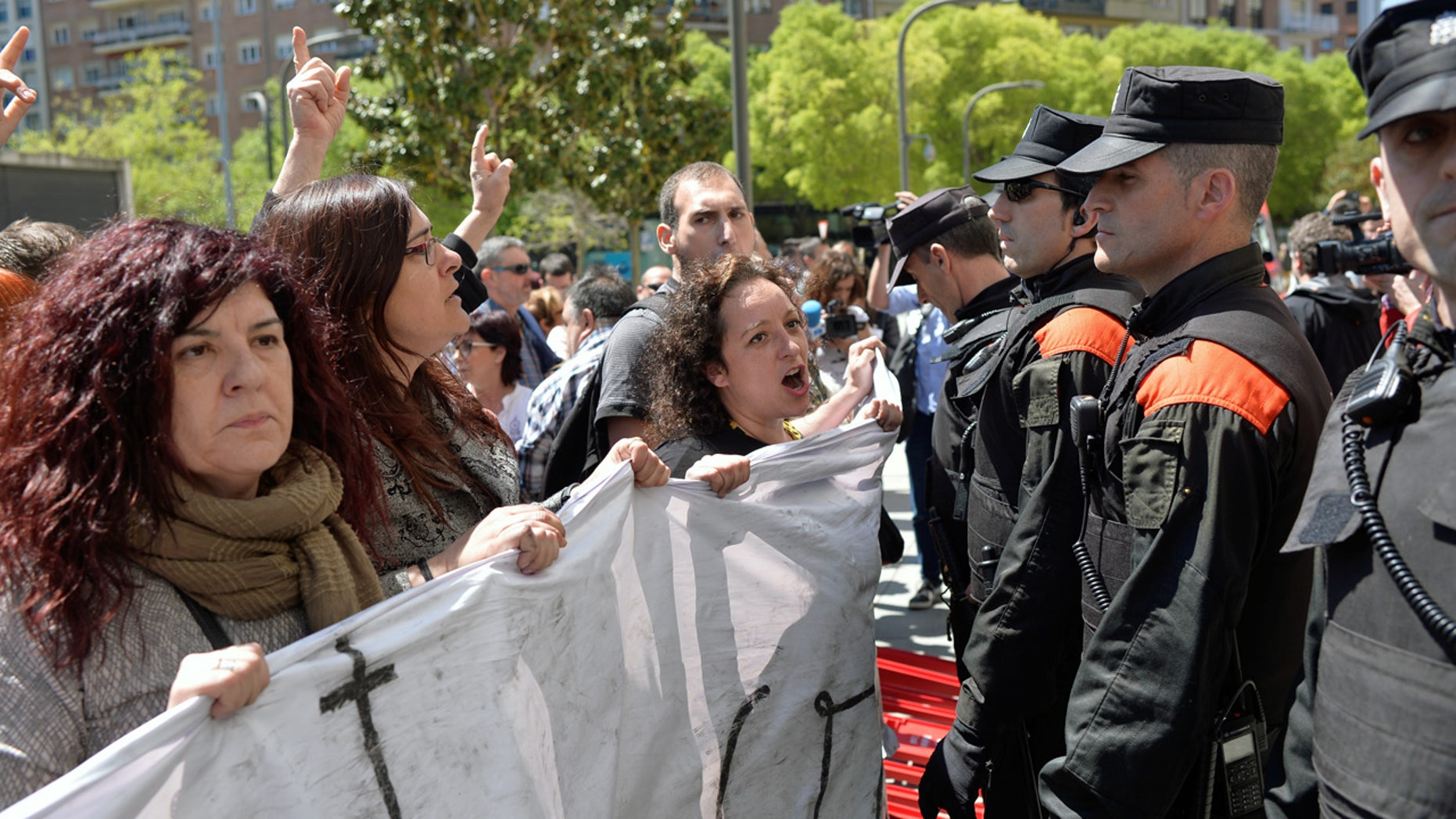 Protesters confront police in Pamplona Thursday after the sentence was announced.