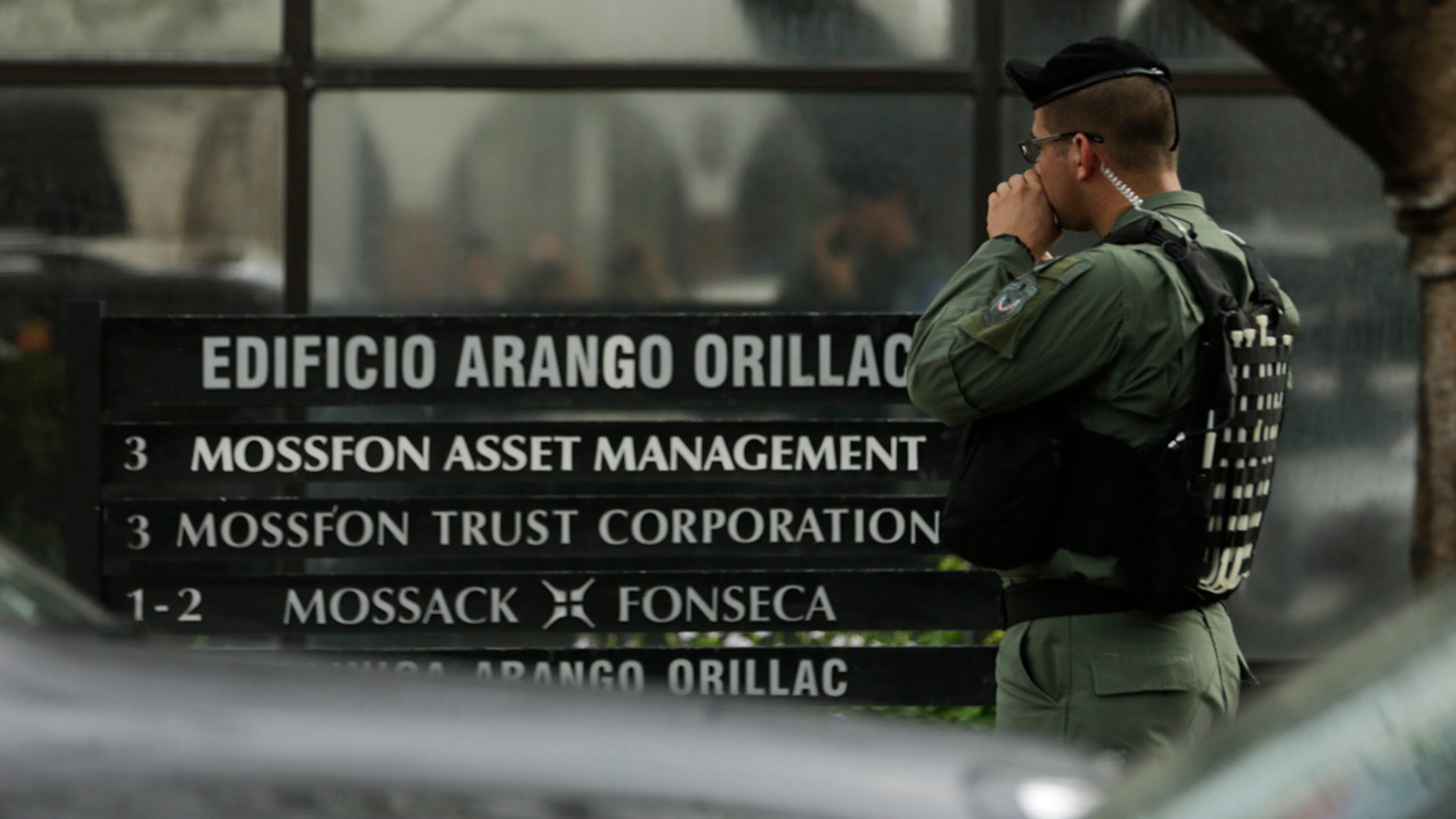 April 12, 2016: A police officer stands outside the Mossack Fonseca law firm while organized crime prosecutors raid its offices in Panama City