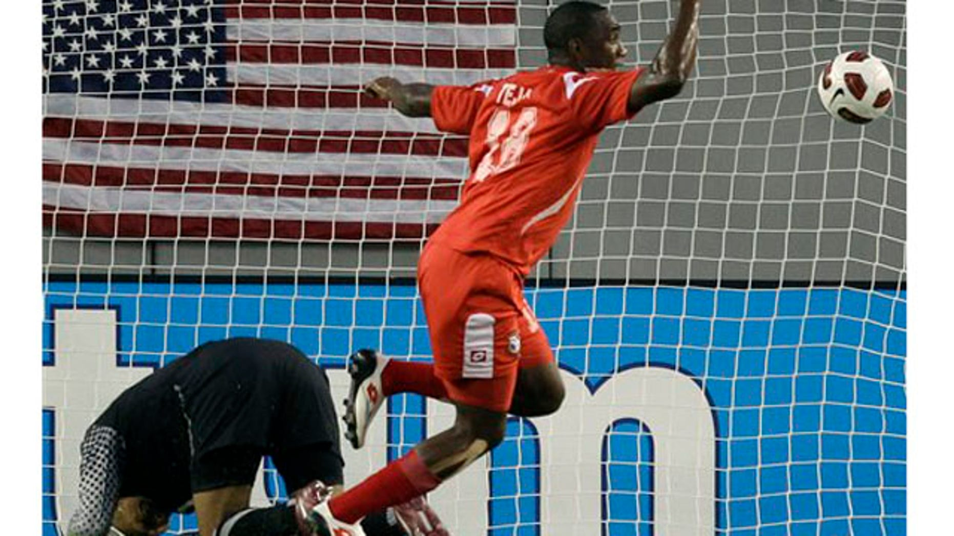 Panama's Luis Tejada (18) celebrates after scoring against United States goalkeeper Tim Howard, left, during the first half of a CONCACAF Gold Cup soccer matchon  Saturday, June 11, 2011, in Tampa, Fla. (AP Photo/Chris O'Meara)