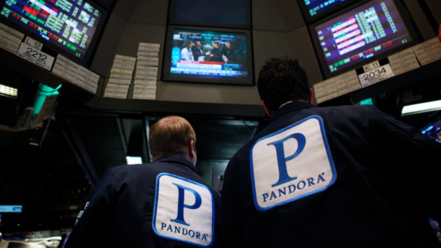 June 15, 2011: Traders work at the kiosk where Pandora Internet radio is traded on the floor of the New York Stock Exchange.