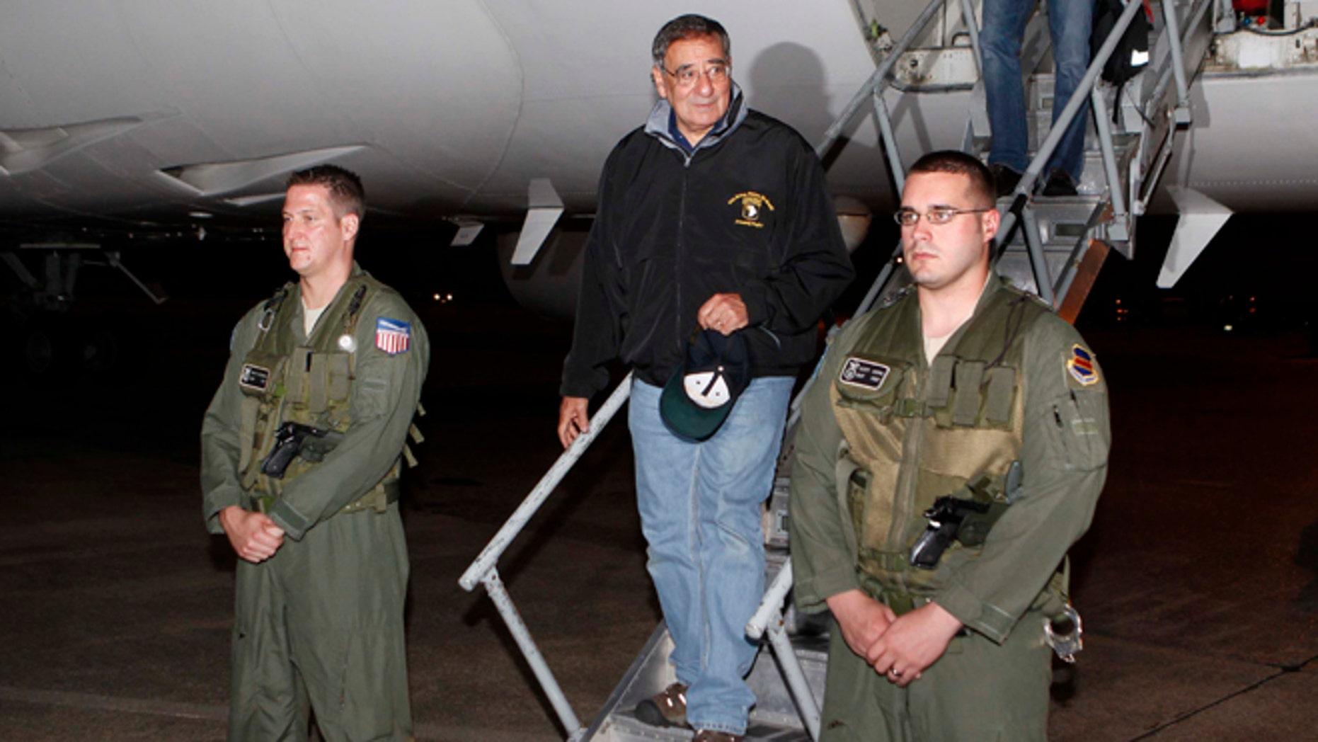 Sept. 16, 2012: U.S. Defense Secretary Leon Panetta, center,  steps off his jet after arriving at Yokota Air Base on the outskirts of Tokyo, Japan.
