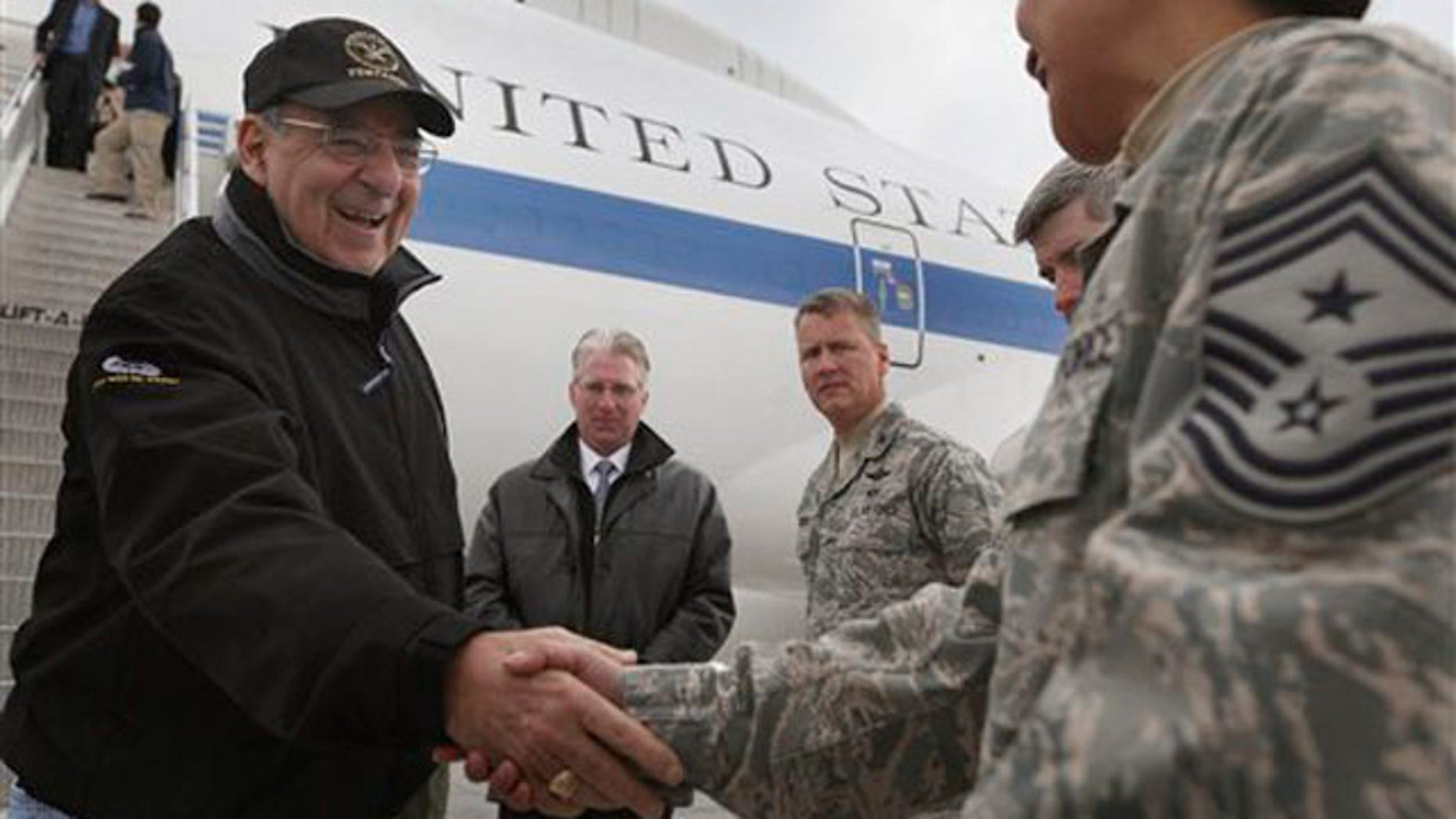 March 13, 2012: Defense Secretary Leon Panetta, left, is greeted as he arrives at the Transit Center at Manas, near Bishkek, Kyrgyzstan.