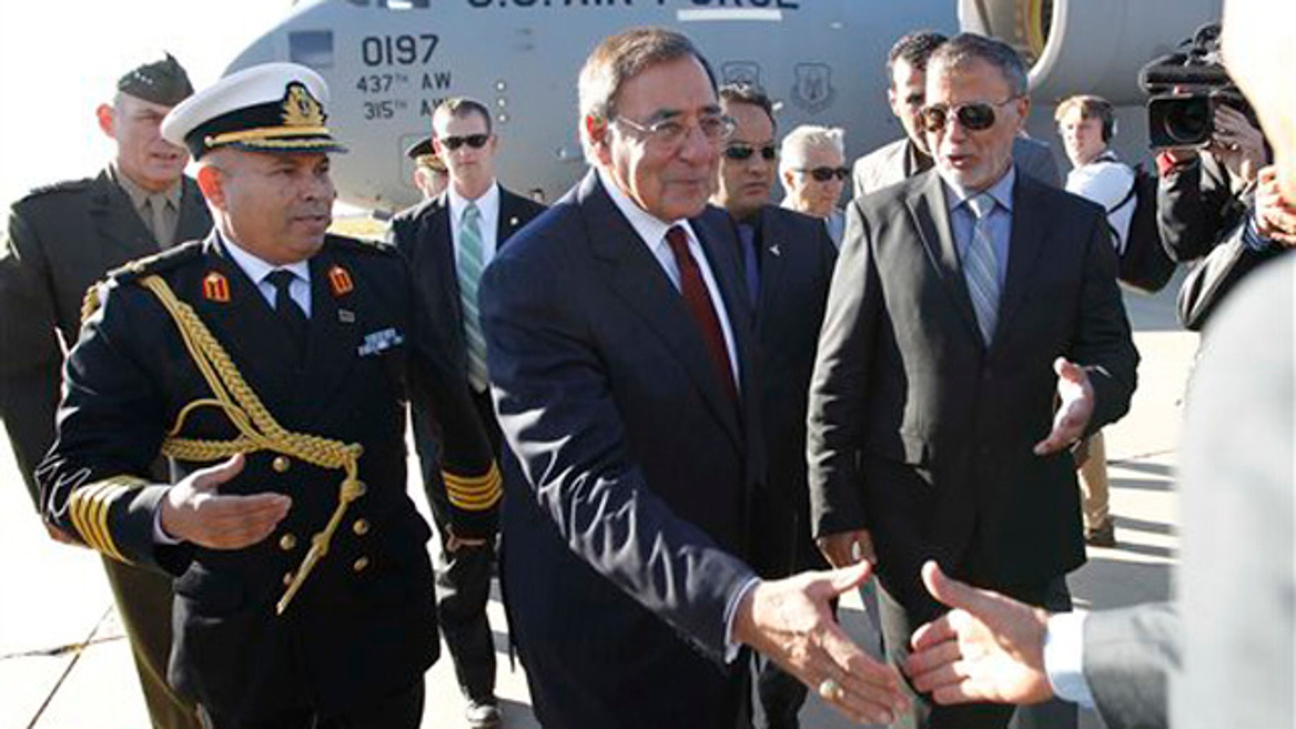 Dec. 17, 2011: Defense Secretary Leon Panetta greets officials in Tripoli, Libya.