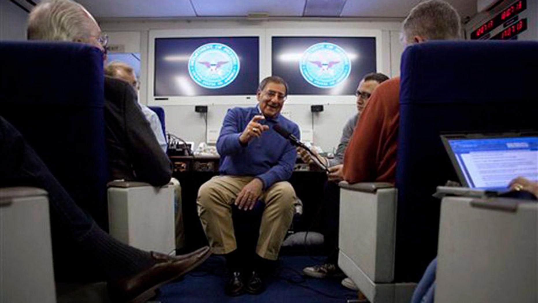 Feb. 1, 2012: Defense Secretary Leon Panetta briefs the media on board a plane en route to a NATO conference in Brussels, Belgium.