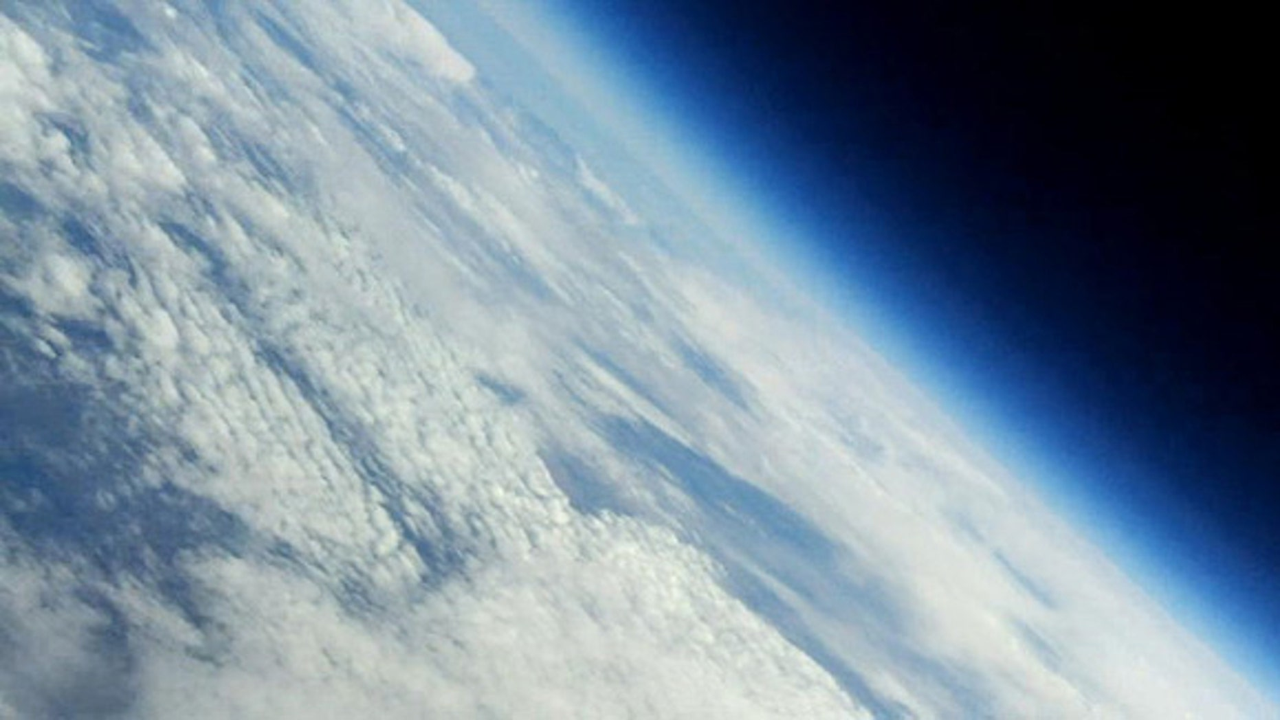 The boundary between Earth and space take center stage in this photo captured by cameras on a balloon-launched paper airplane built by space enthusiasts at The Register in the U.K. The plane was carried to an altitude of about 17 miles before descending back to Earth on Oct. 28, 2010.
