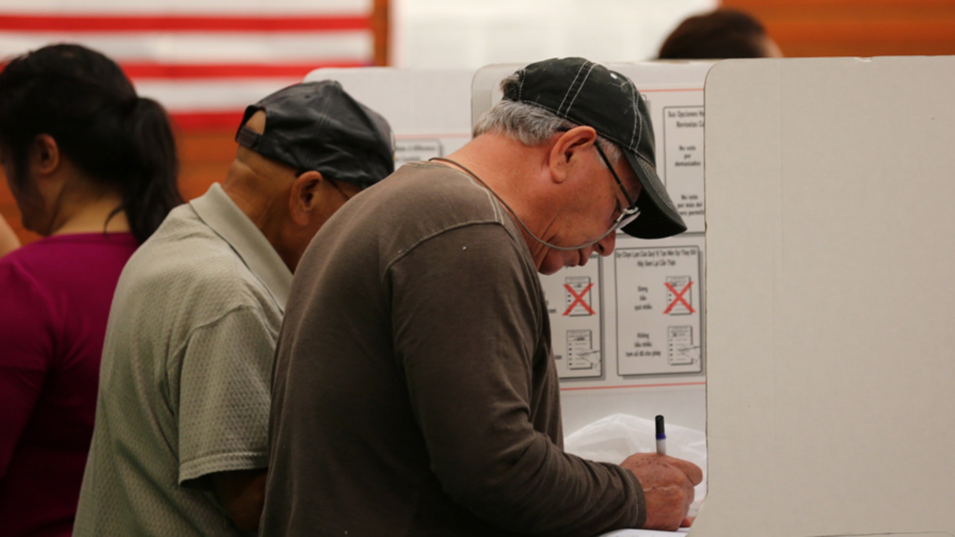 California voters are seen casting ballots in the November 2016 election. California is one of the states where local jurisdictions use 'ranked-choice voting,' something Maine is struggling to implement statewide.