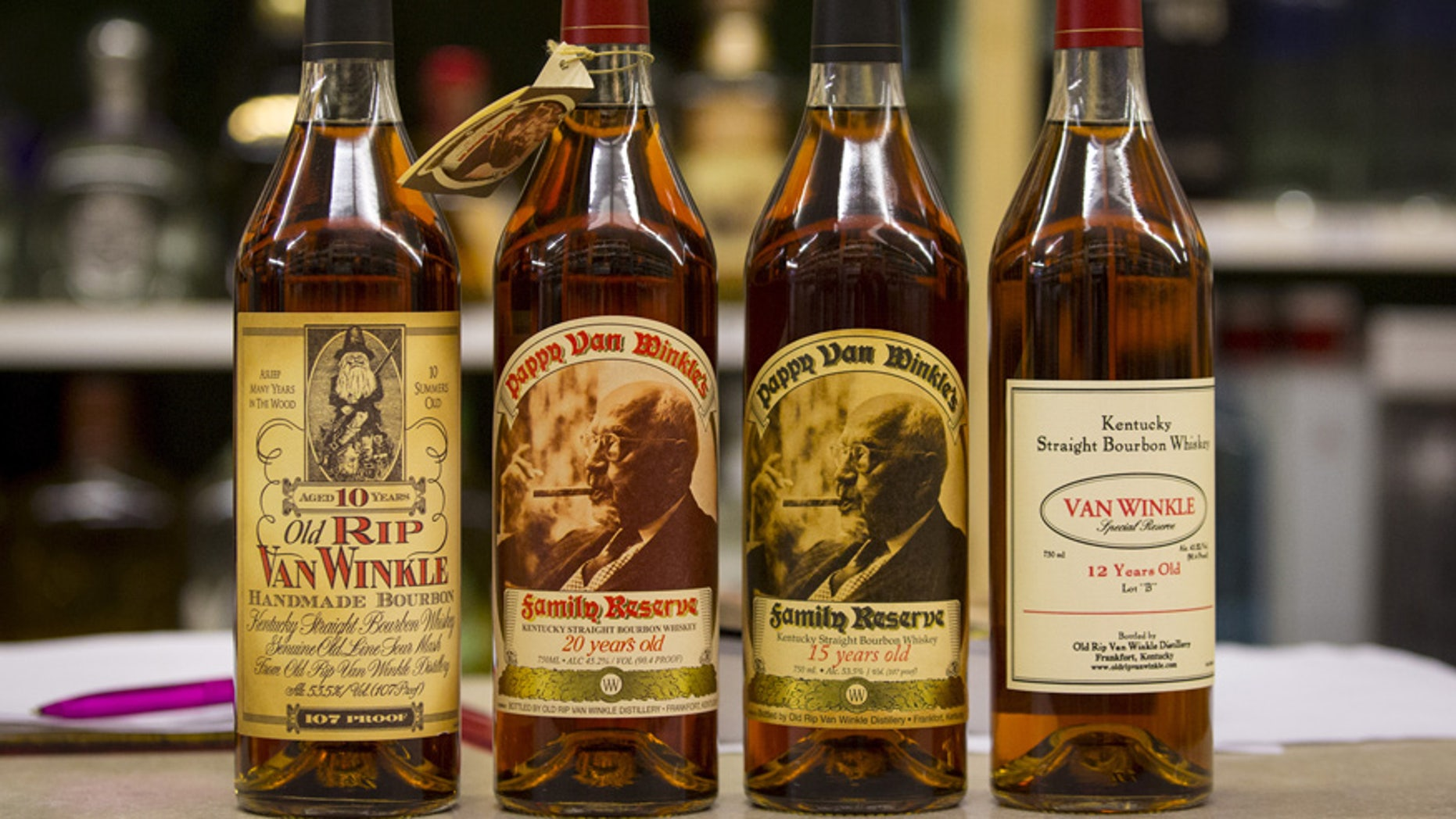 Bottles of Pappy Van Winkle are displayed in a liquor store.