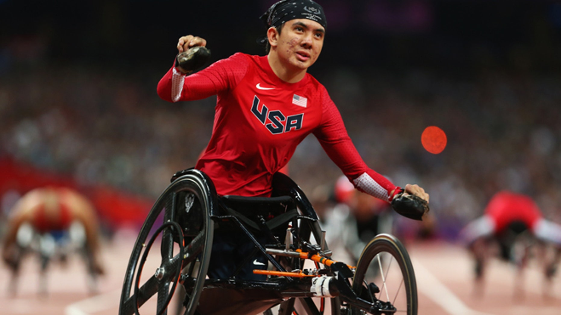 LONDON, ENGLAND - SEPTEMBER 08:  Raymond Martin of the United States celebrates as he wins gold in the Men's 200m T52 Final on day 10 of the London 2012 Paralympic Games at Olympic Stadium on September 8, 2012 in London, England.  (Photo by Michael Steele/Getty Images)