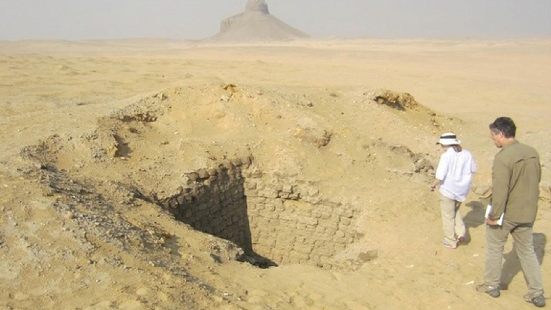 Months after seeing evidence of looting from space, Parcak and her colleagues went to look at the looting pits in Dahshur for themselves. This one was 10 meters (33 feet) deep.