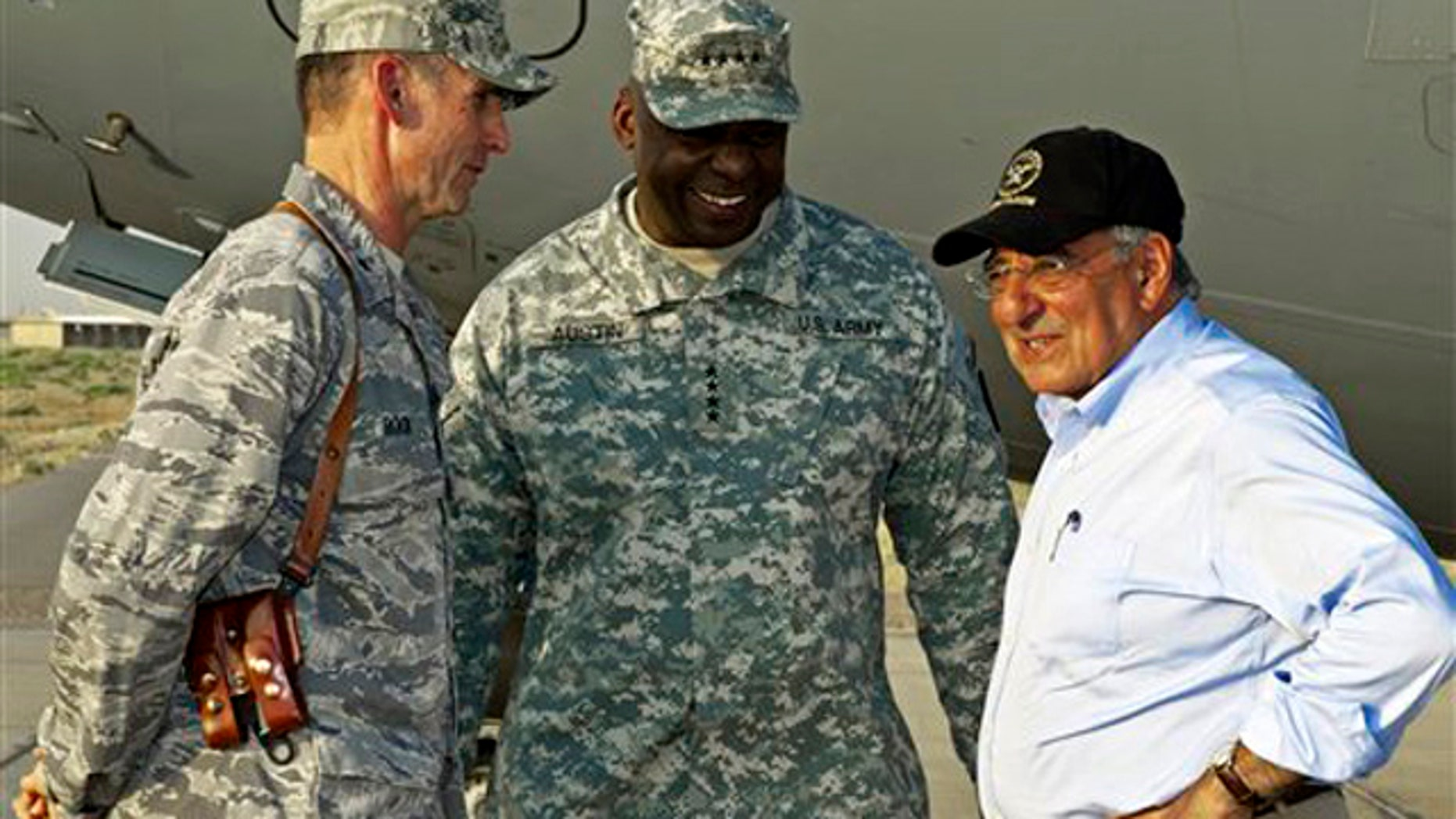 US Secretary of Defense Leon Panetta, right,  has a brief chat with his US Generals Anthony Rock, left, and Lloyd Austin, late Sunday July 10, 2011, during an unannounced visit by the U.S. Secretary to Camp Dwyer, Sunday July 10, 2011, in southern Afghanistan. (AP  Photo/Paul J. Richards, Pool)