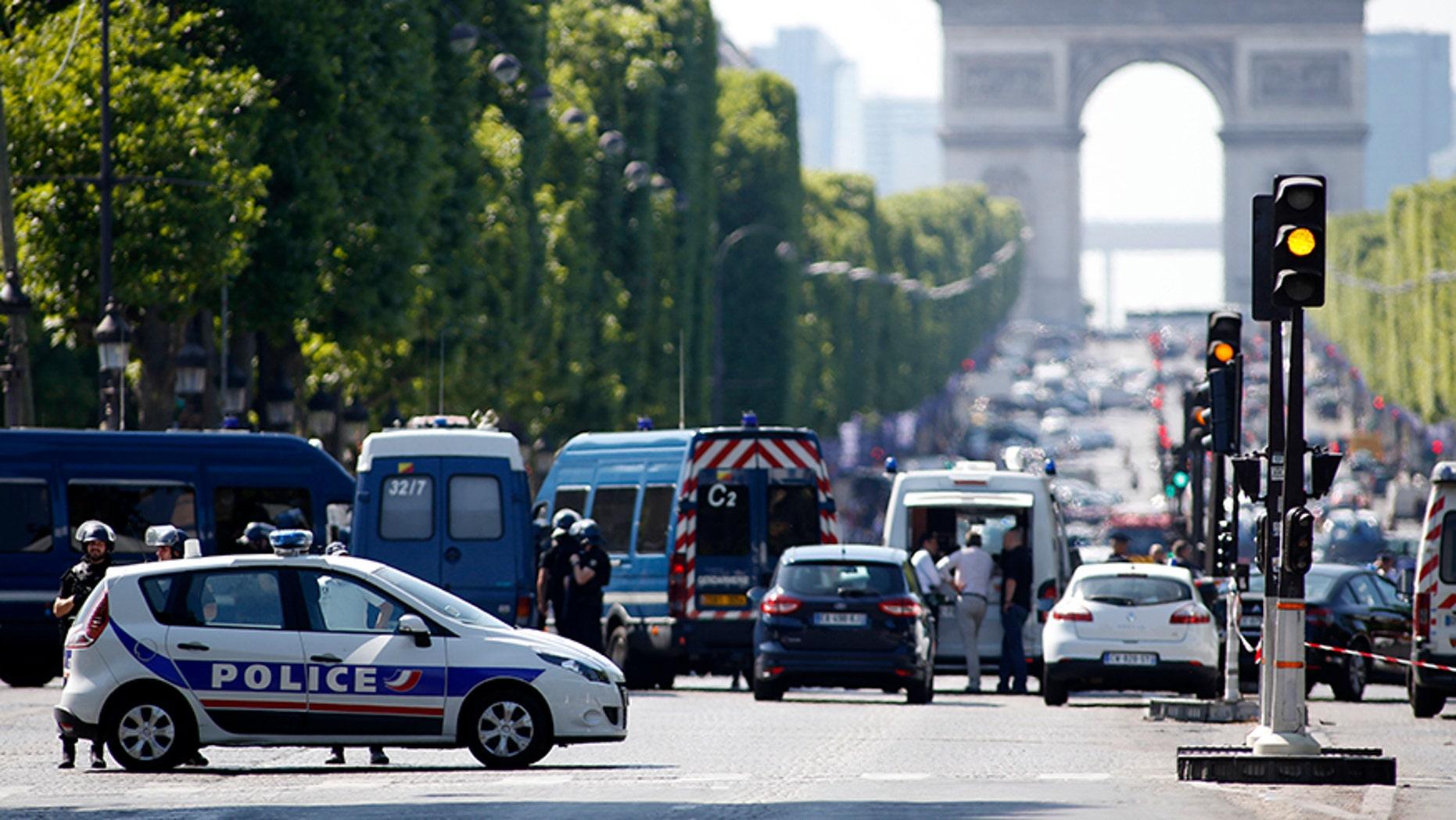June 19, 2017: Police forces secure the area on the Champs Elysées in Paris.