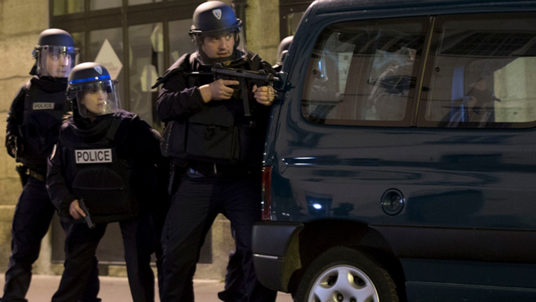 Nov. 15, 2015: French police secure the perimeter after panic broke out among mourners who payed their respect at the attack sites at restaurant Le Petit Cambodge (Little Cambodia) and the Carillon Hotel in Paris.