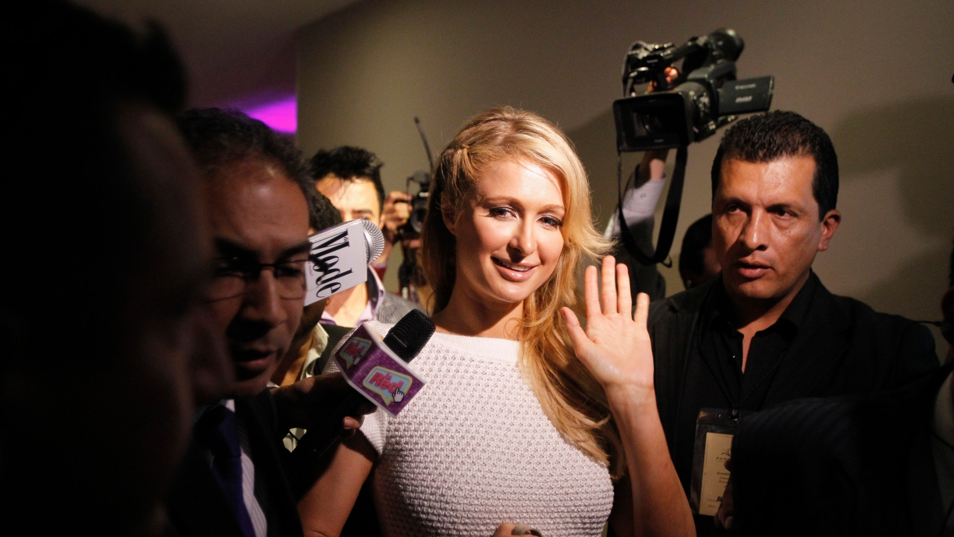U.S. socialite Paris Hilton waves after a news conference during the launch of her latest store in Bogota, April 24, 2013.